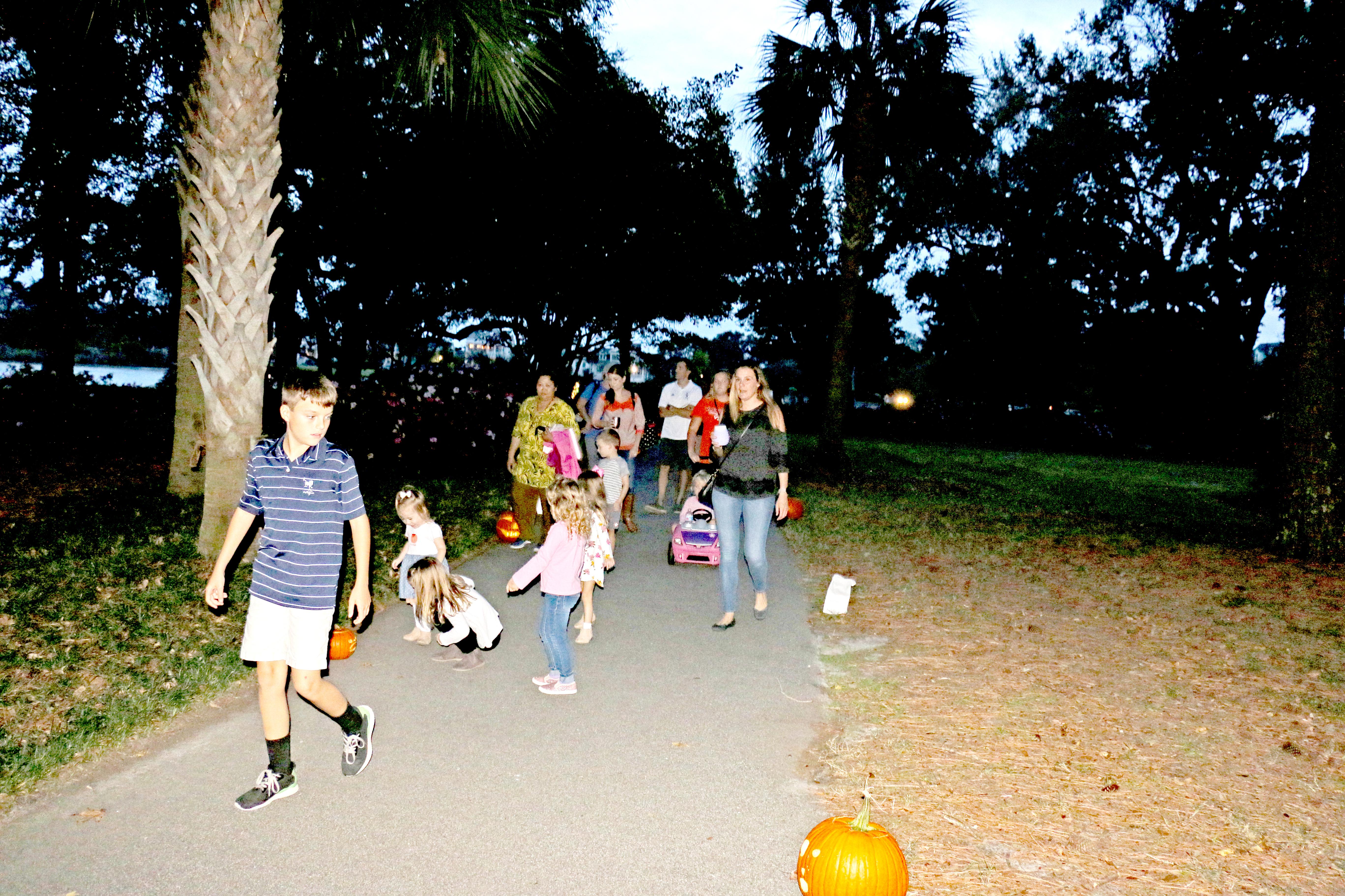 Folks of all ages enjoy a walk along the pumpkin path.