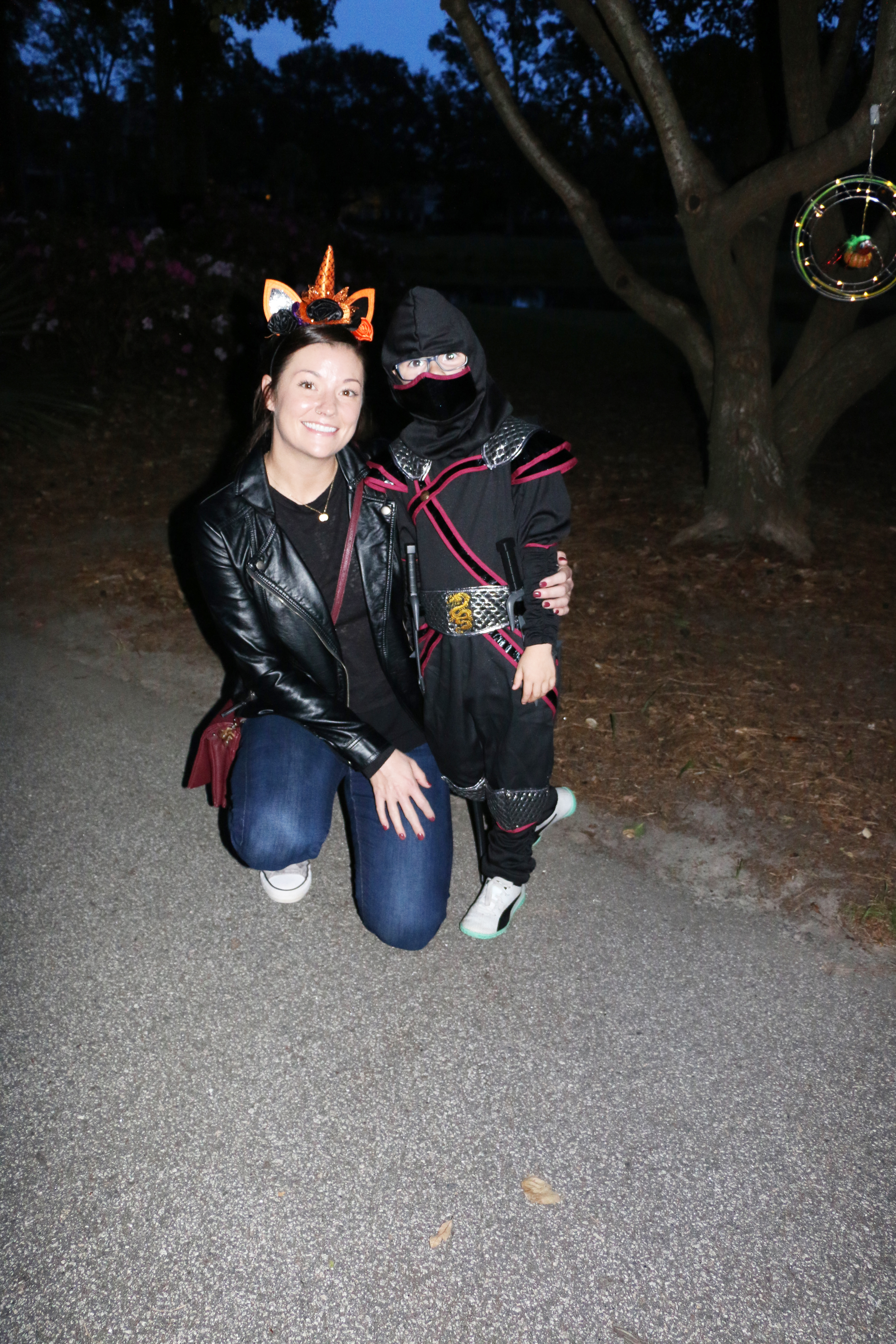 Kelly the cat and Calvin the Ninja are spotted at the annual Pumpkin Walk last Saturday at Smythe Lake Park.