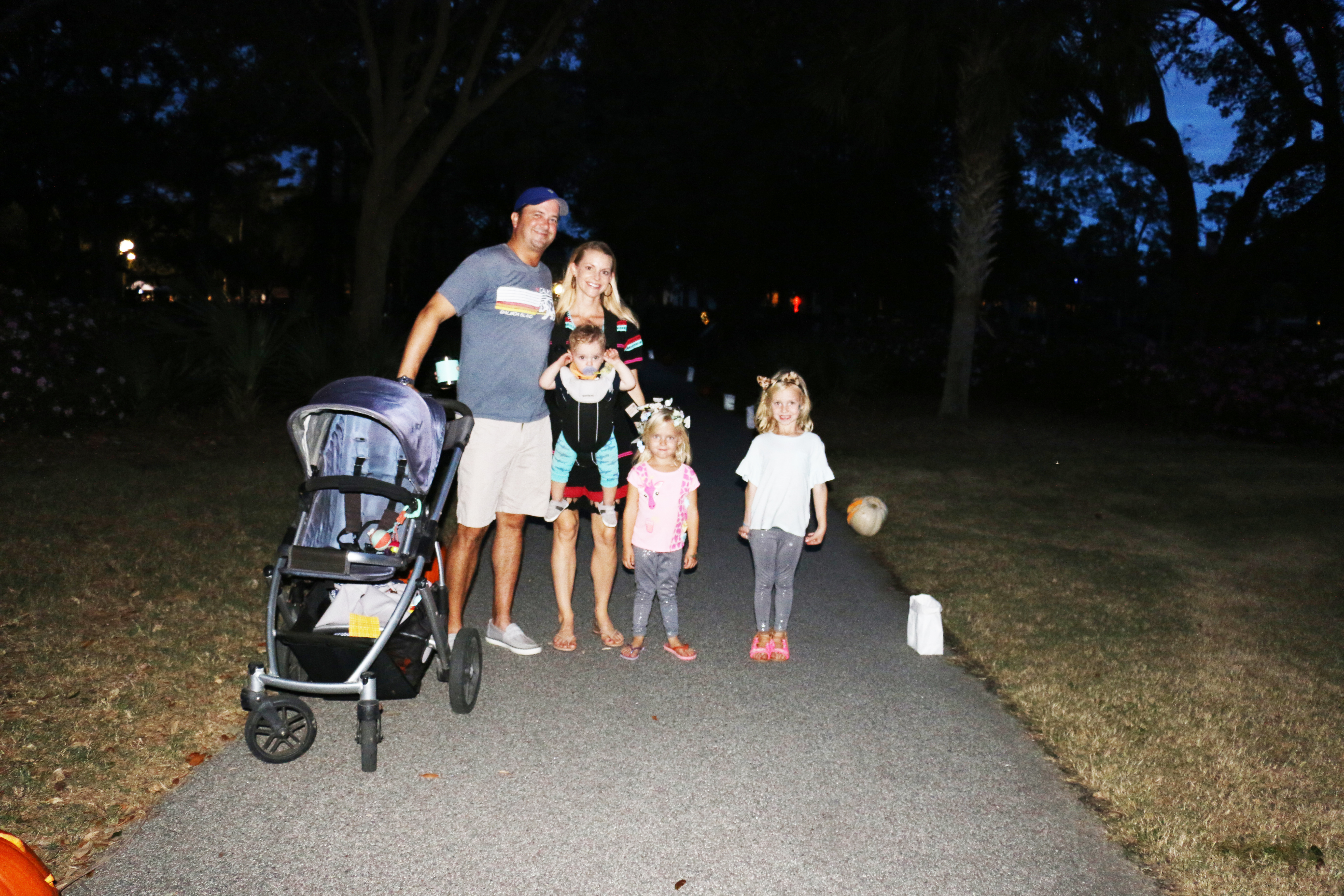 The Brittingham Family strolls the walking path lined with decorated pumpkins.