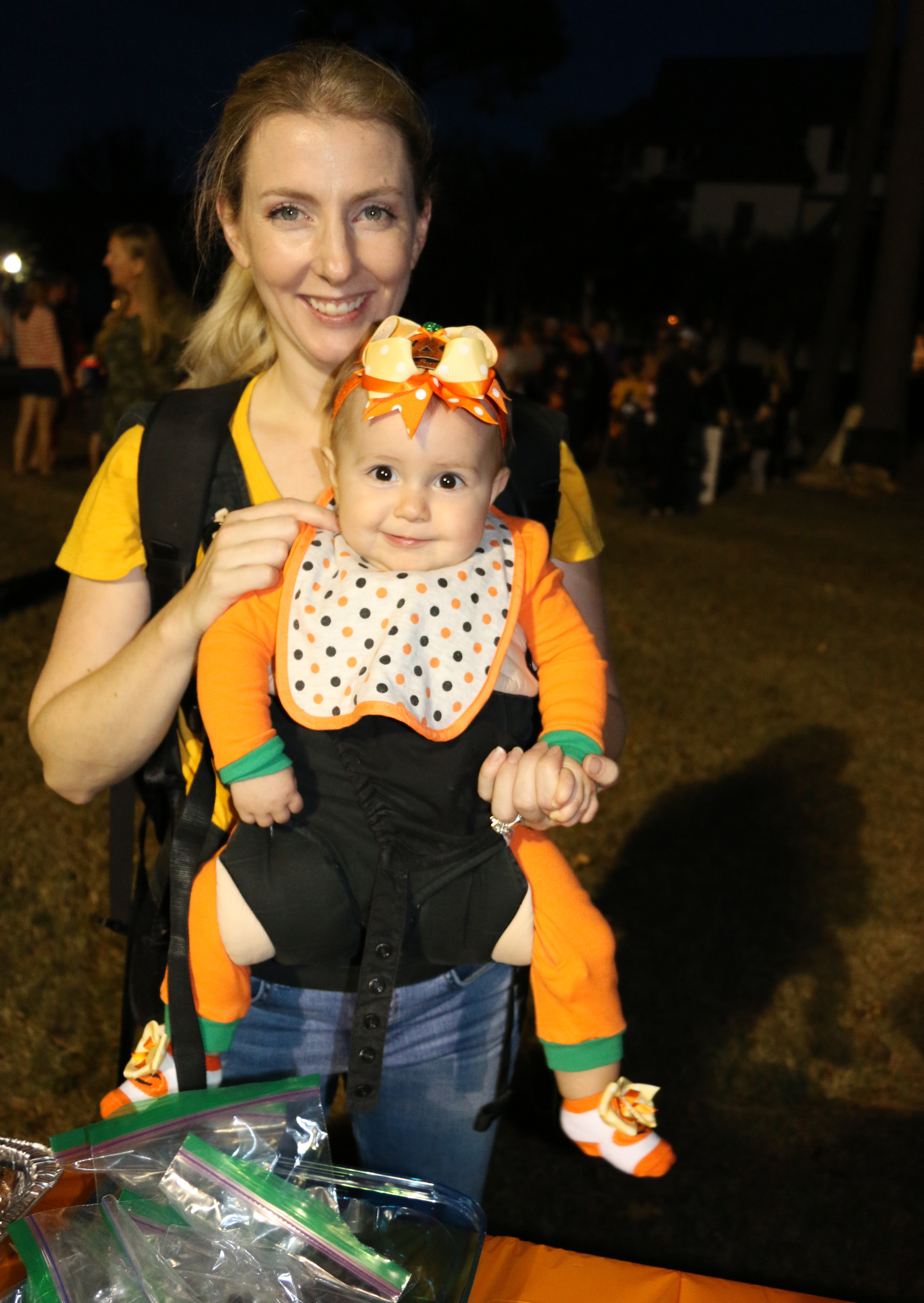 Kate Orcella carriers her little pumpkin, Mia.