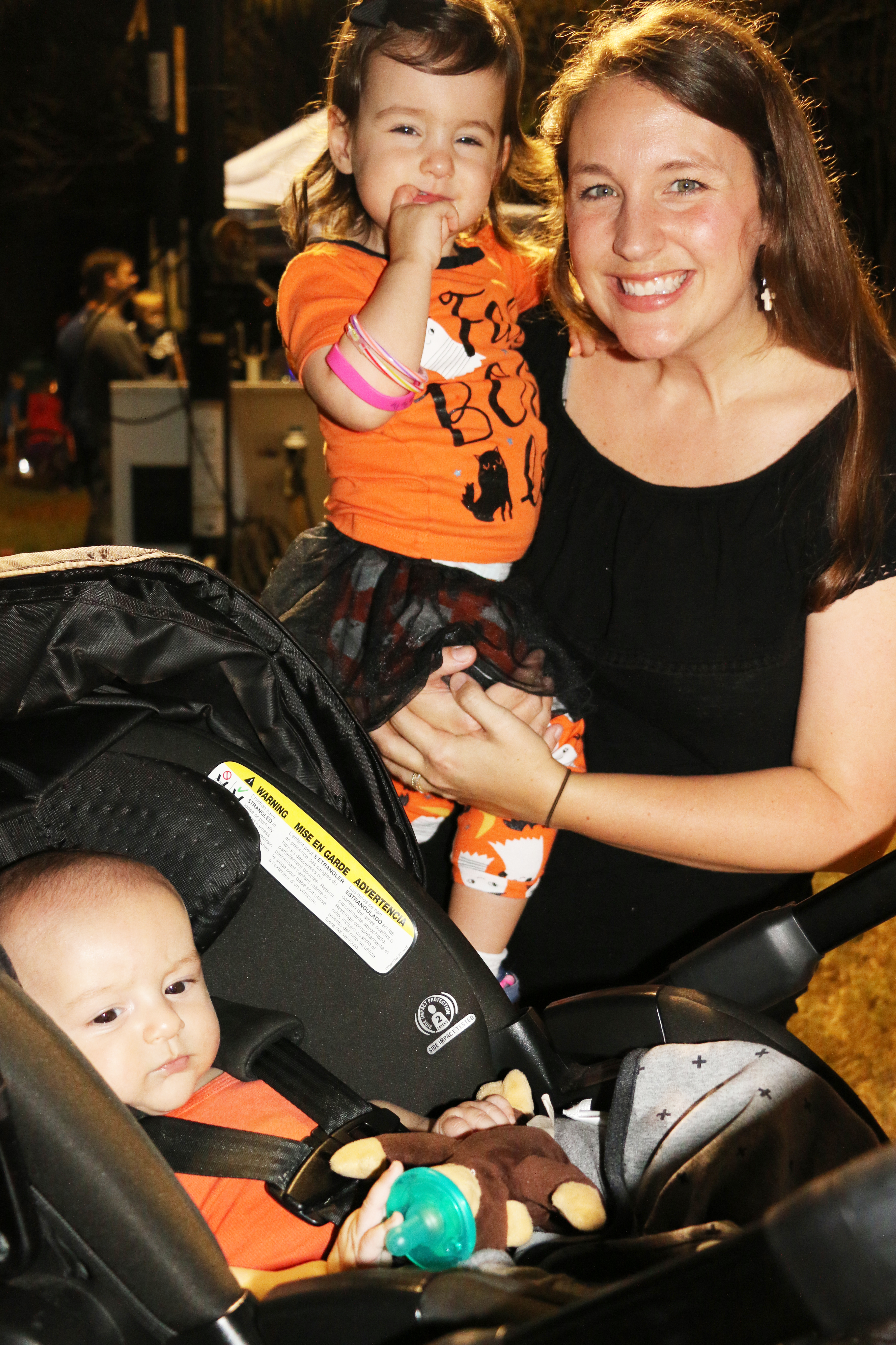 It's a family affair: Baby Luke, Sister Hope and mom Brianna Gibson take in the festivities.