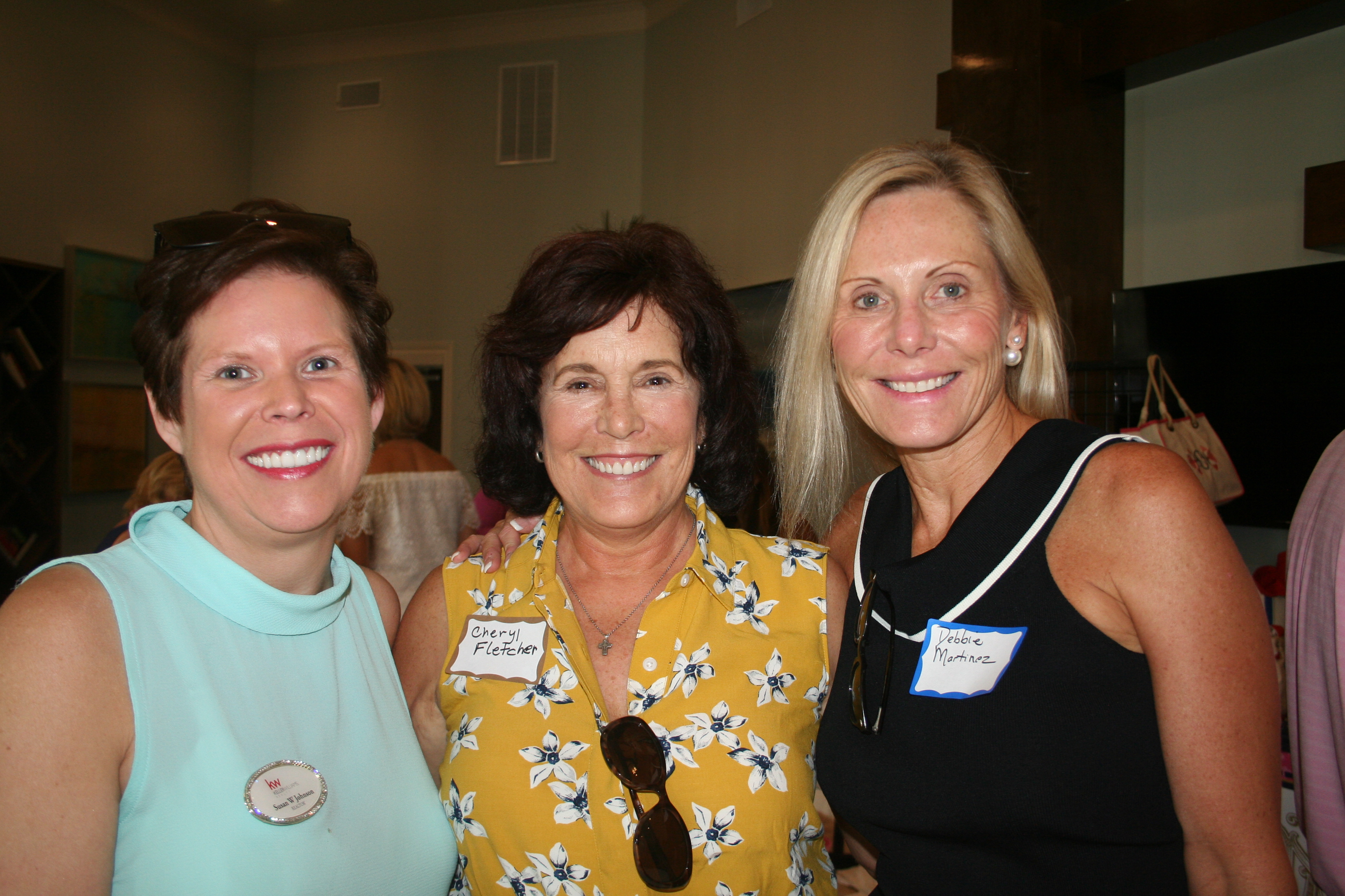 Local realtor Susan Johnson, and attorneys Cheryl Fletcher (former DIBA president) and Debbie Martinez touch base at the block party.
