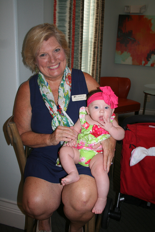 Deedee Malley is a volunteer with the Cares Program at Greystar's Daniel Island Village. Granddaughter Sofie Rose is the perfect spokesperson!