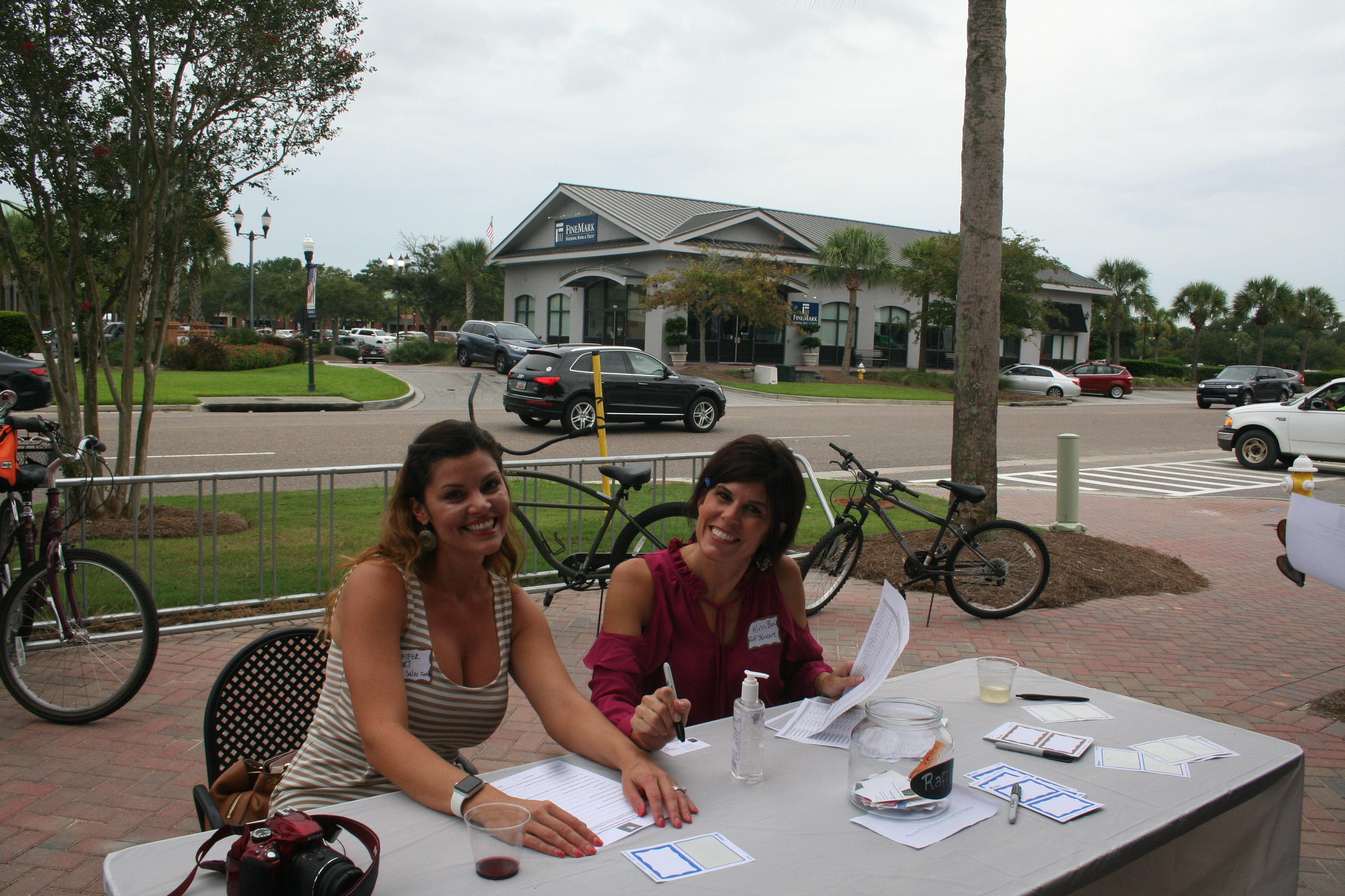All smiles! Jennifer Fort and Kim Blank man the membership and sign in booth.