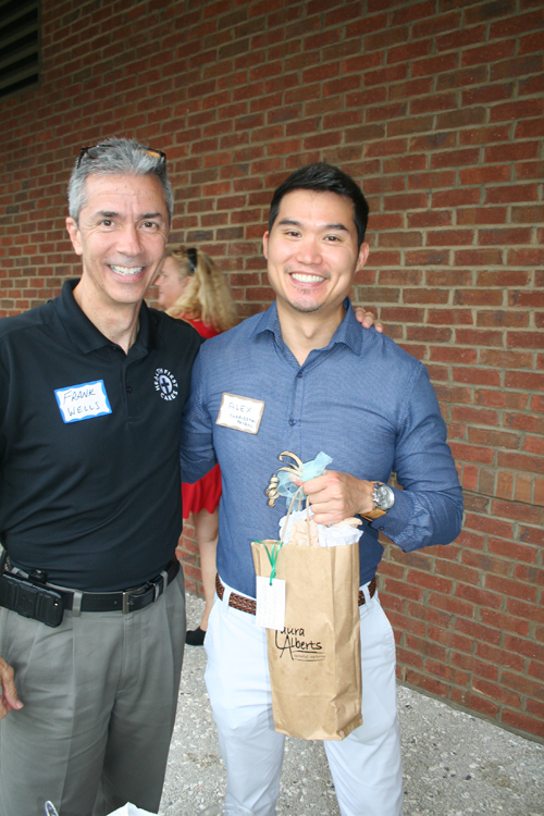 Swag Winner! Alex Shi (right), pictured with Frank Wells, won a door prize at the happy hour.