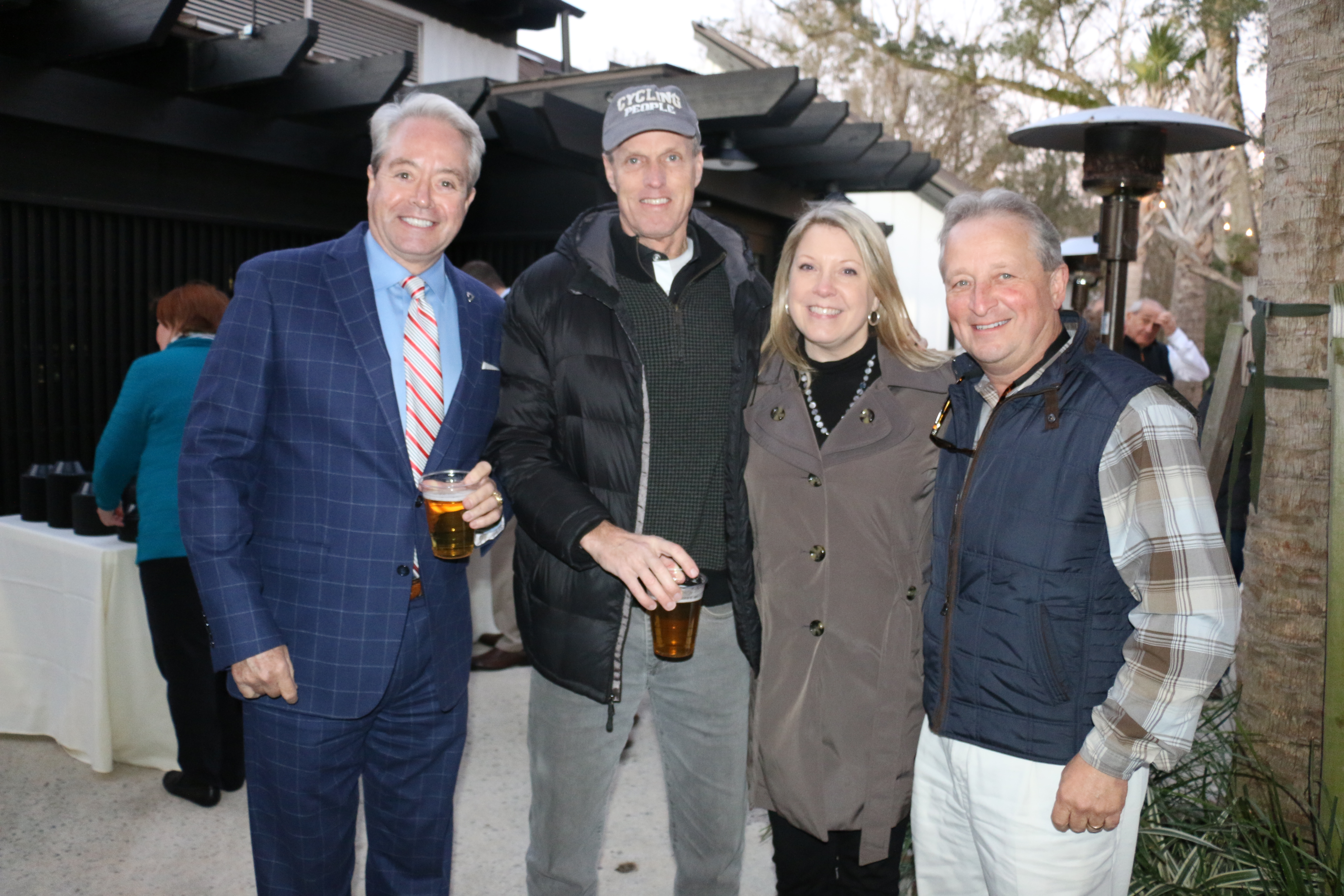 Local real estate agents Mike White, Rick Adams, Chris Phillips and Jeff Leonard show solidarity at the oyster roast last Thursday, Feb. 27.