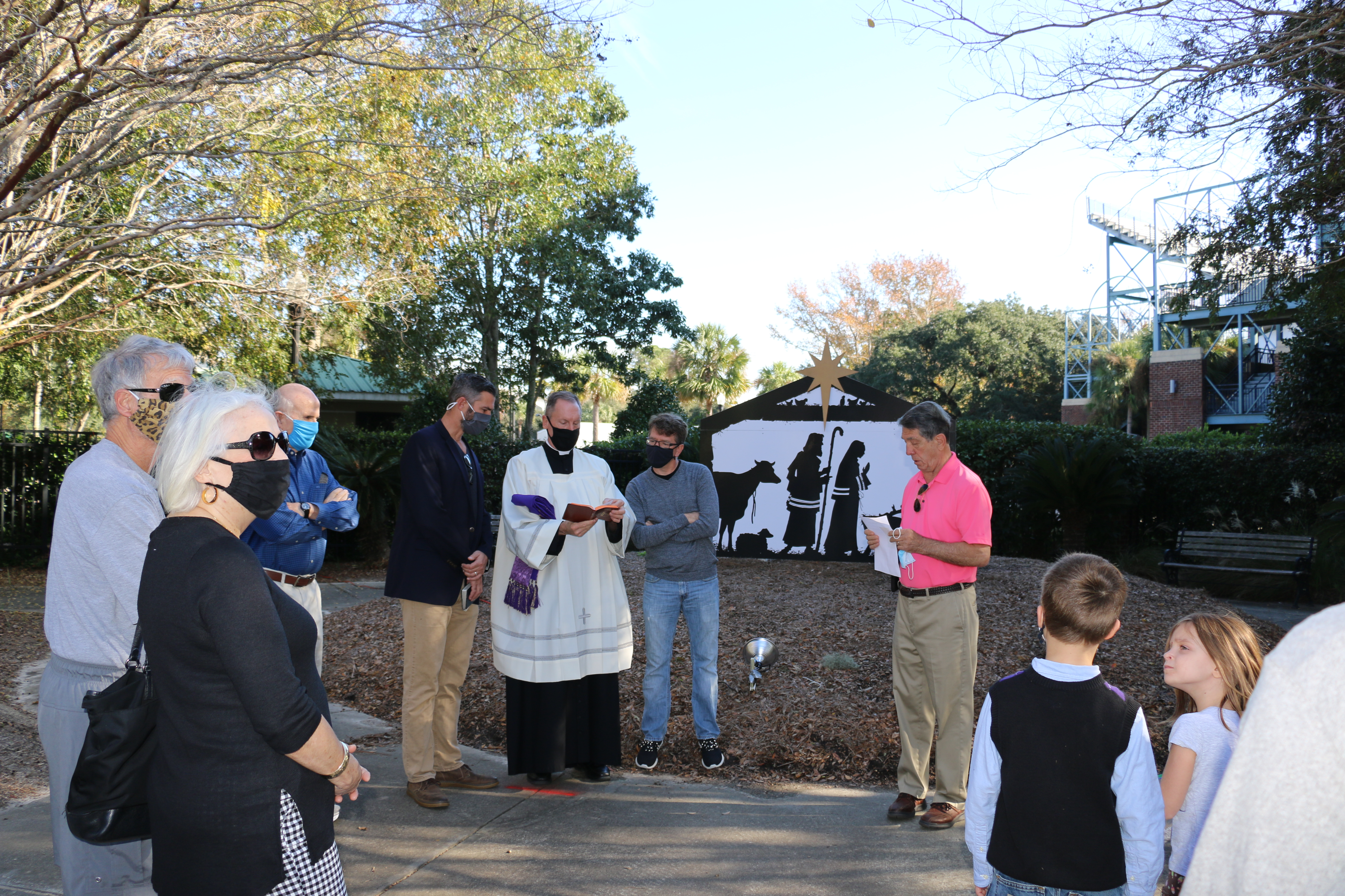 On Dec. 12, pastors from island churches shared scripture, prayer, and words of hope at the Blessing of the Nativity. The new nativity display was spear-headed by Frank Walsh and built by Johnston Signs. The nativity is on display in front of the Volvo Car Stadium. Pictured are: Pastor Paul Sorensen of One Fellowship, Father West of St. Clare of Assisi, Pastor Freemyer of Providence Church, and Frank Walsh.