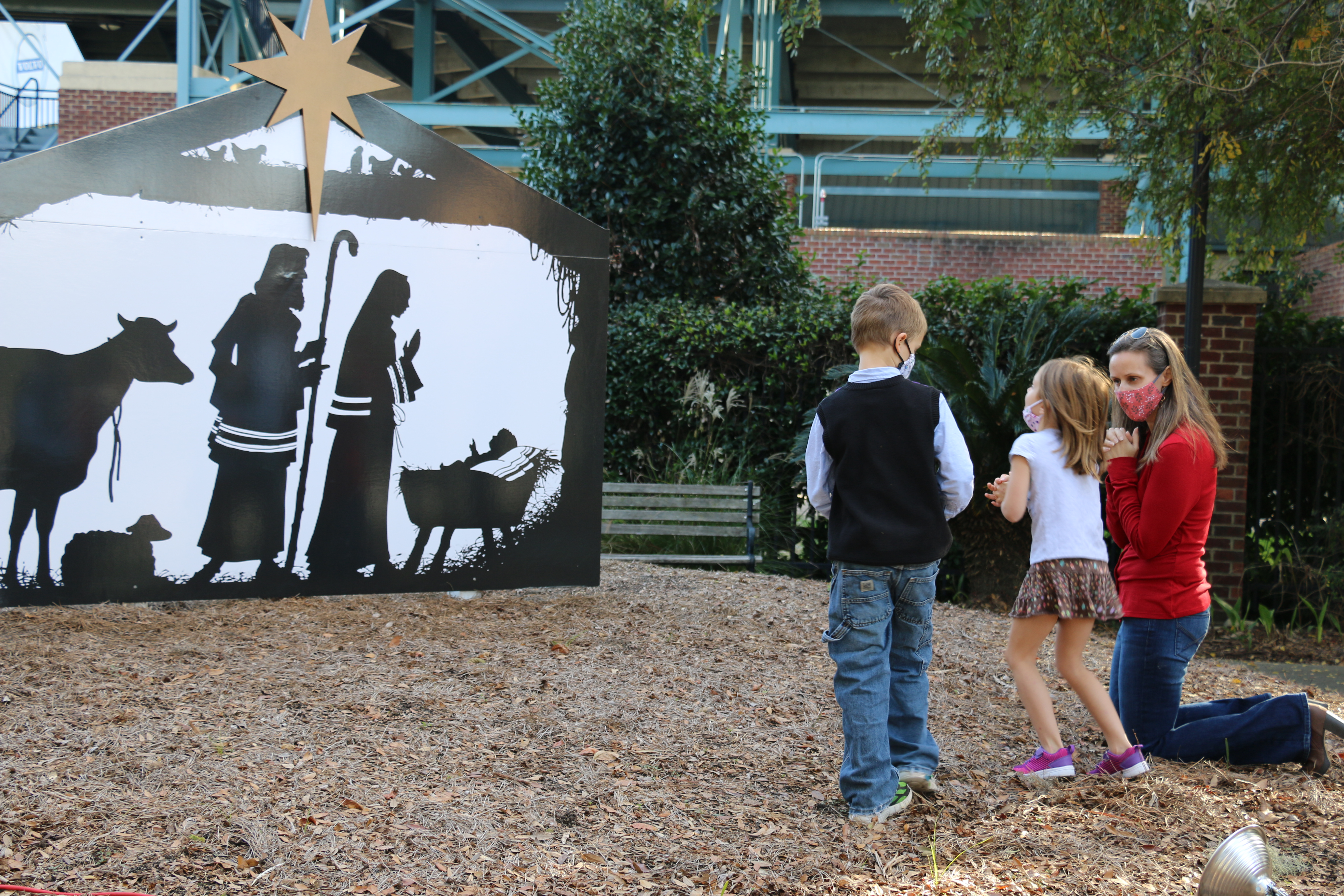 Regan, and her mother Elizabeth DeStefano, pray before the recently blessed nativity display.