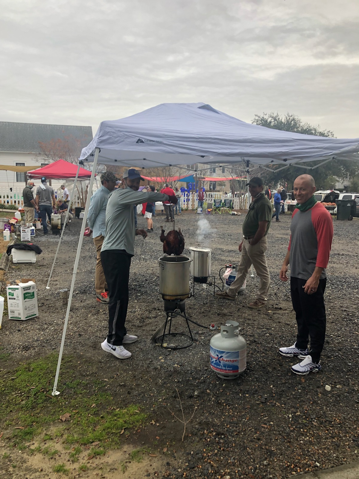 Casey Kellermann and Chris Gregory, with other community volunteers, gathered in the parking area at the Church of the Holy Cross on Daniel Island Christmas Eve to fry turkey  dinners for those in need.