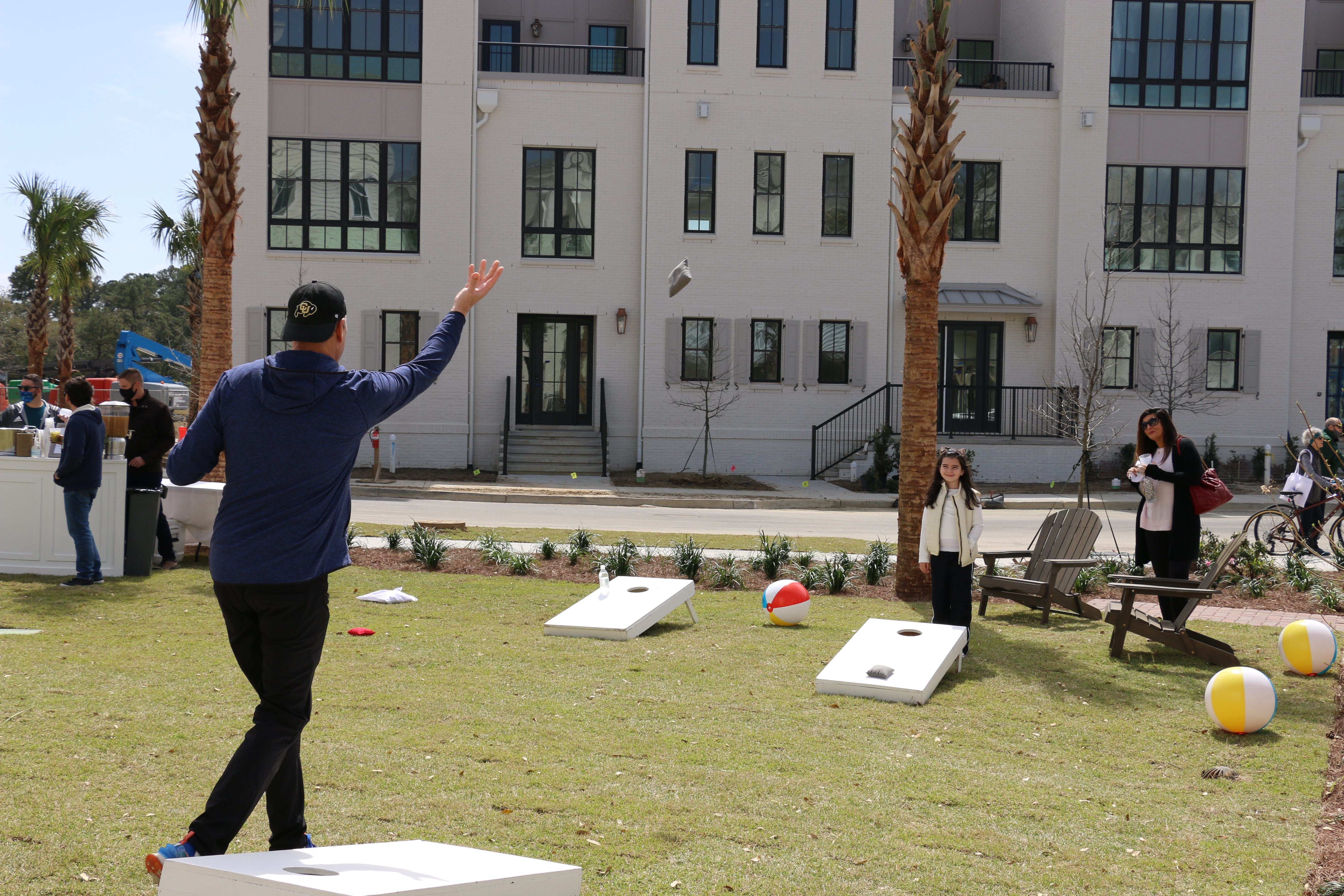 Cornhole was one of many activities available for guests attending the grand opening of The Waterfront on Daniel Island. The community area adjacent to condominiums and townhouses offers a green space that is perfect for playing games.