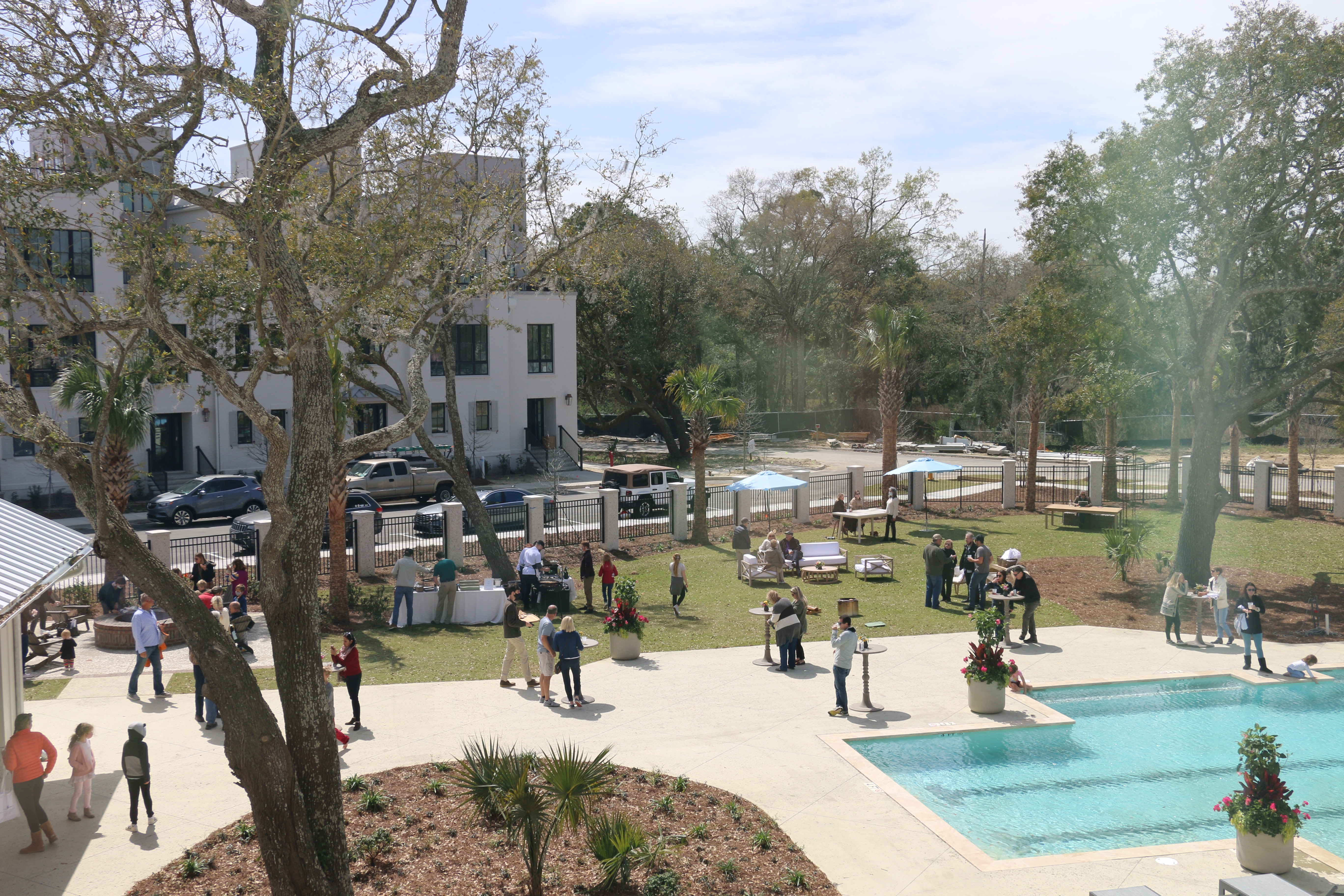 An aerial view of the festivities of Waterfest at the grand opening of The Waterfront. This vantage point is from one of the condominiums and townhouses adjacent to the community complex that includes a greenspace and a gated pool area.