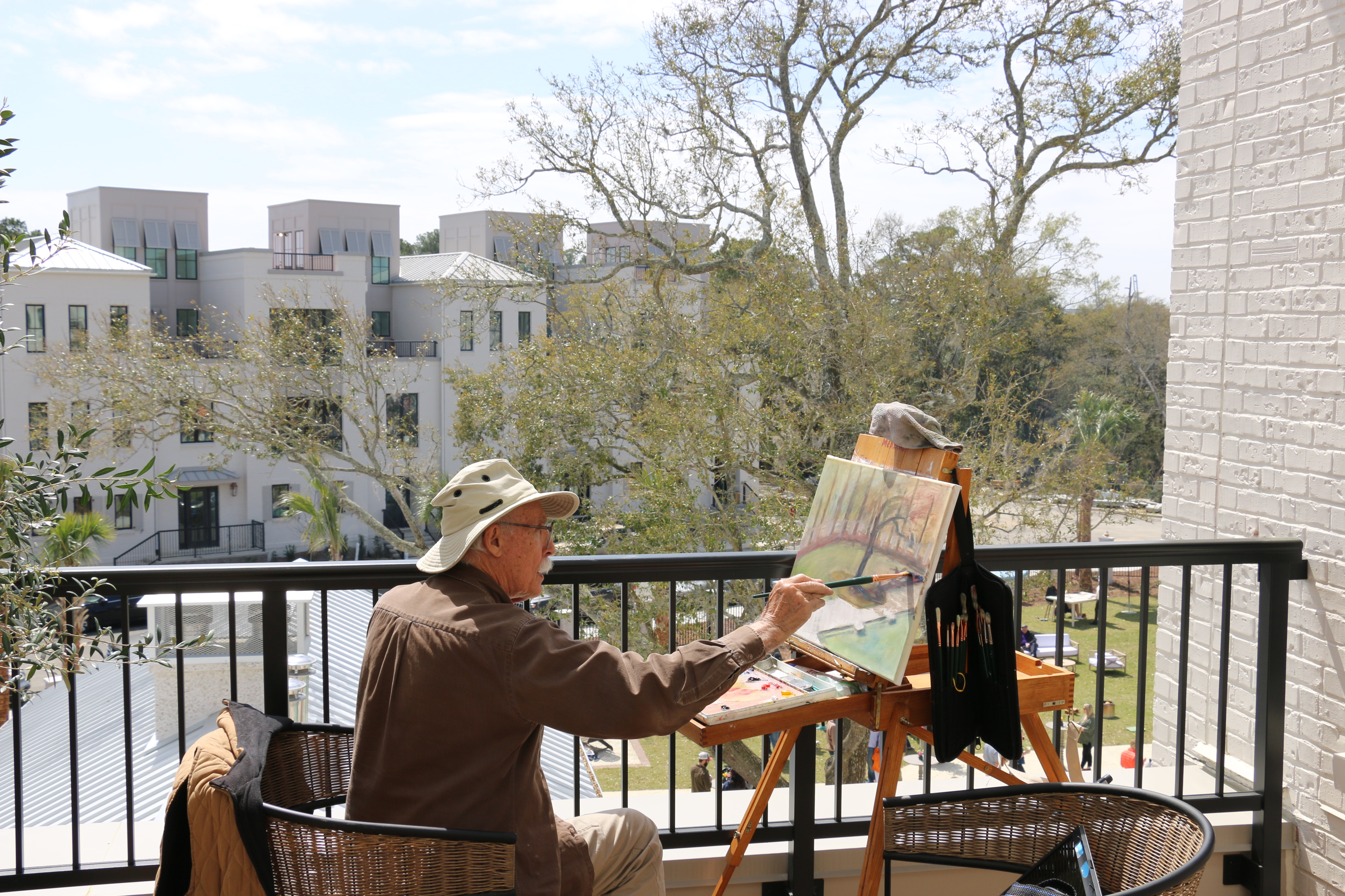 Artist Thomas Meddaugh (tmmart.net) of the Mount Pleasant Artists Guild painted a scene while overlooking the festivities of Waterfest from a balcony.