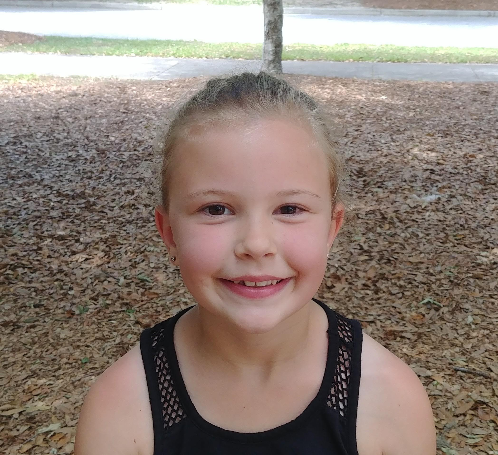 I would be a cat superhero because I love cats and they can jump really high and they are super fast.  Jennifer  Age 7  Summerville