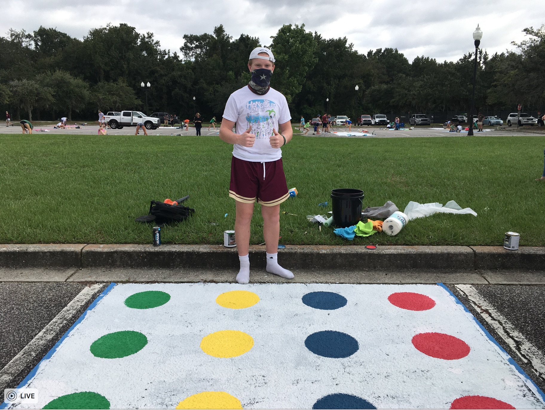 "Kevin Drennan, 17, painted his parking space themed after the widely popular game Twister. ""It's creative, and it's not too complicated,"" Drennan said."