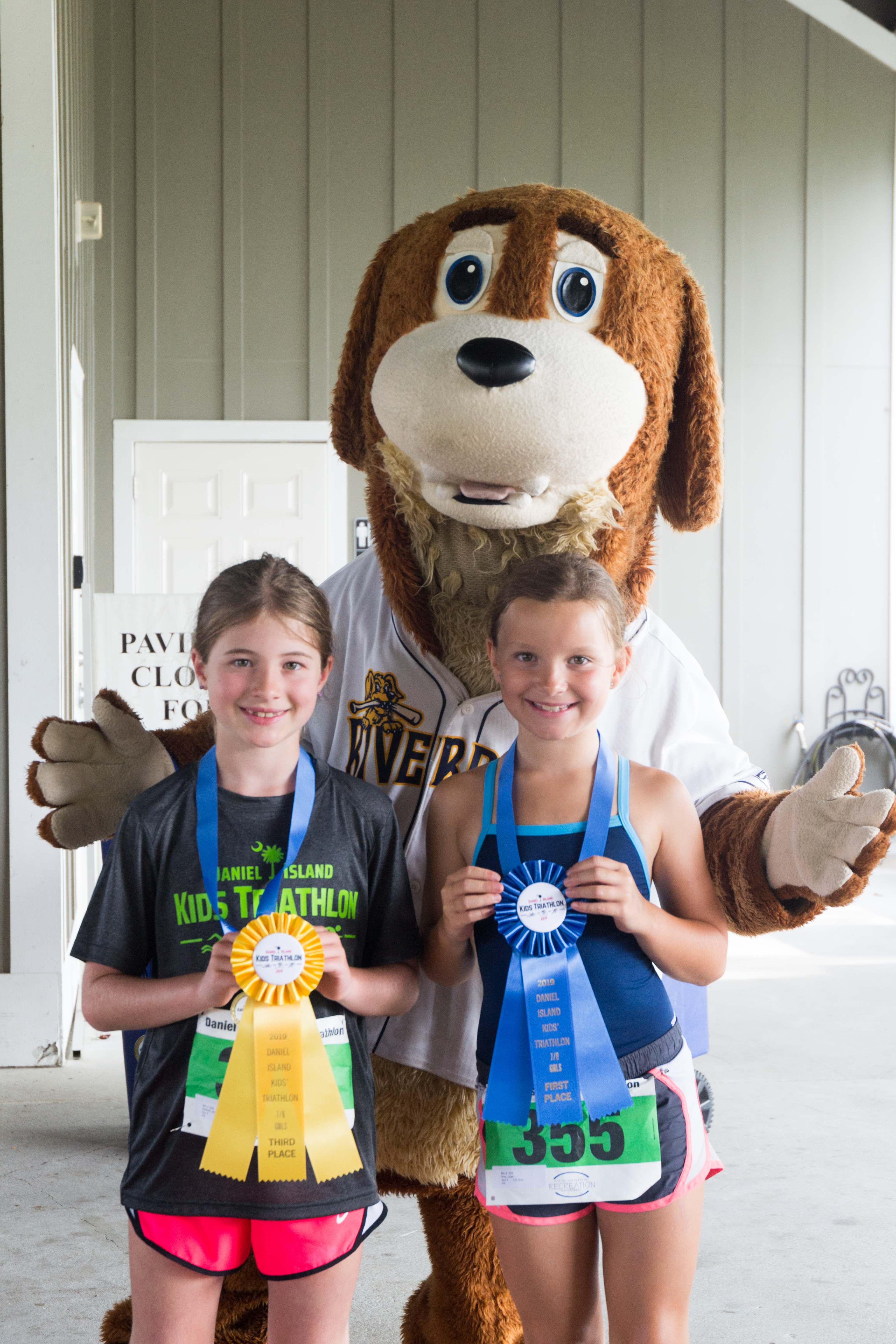 Winners in the 7-8 year-old girls' category (100 meter swim, 2.4 mile bike, ½ mile run): Lilah May (1st), Sarah Ligon (2nd – not pictured), and Bridgette DeWolf and Madelyn Moore (tied for 3rd - Moore not pictured).