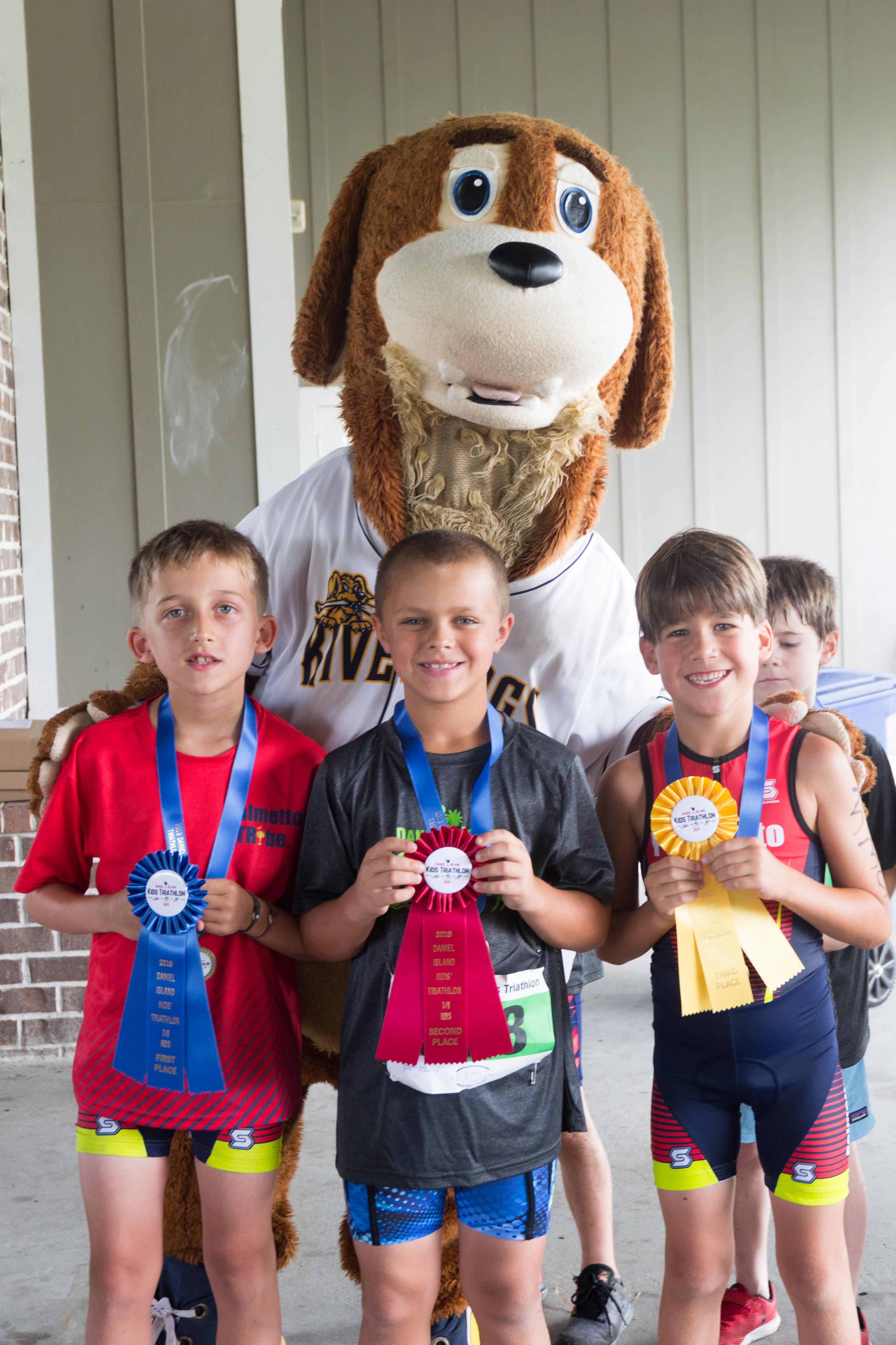 Winners in the 7-8 year-old boys' category (100 meter swim, 2.4 mile bike, ½ mile run): John Warren Cason (1st), Jason Chalupsky (2nd) and Brody Jones (3rd).