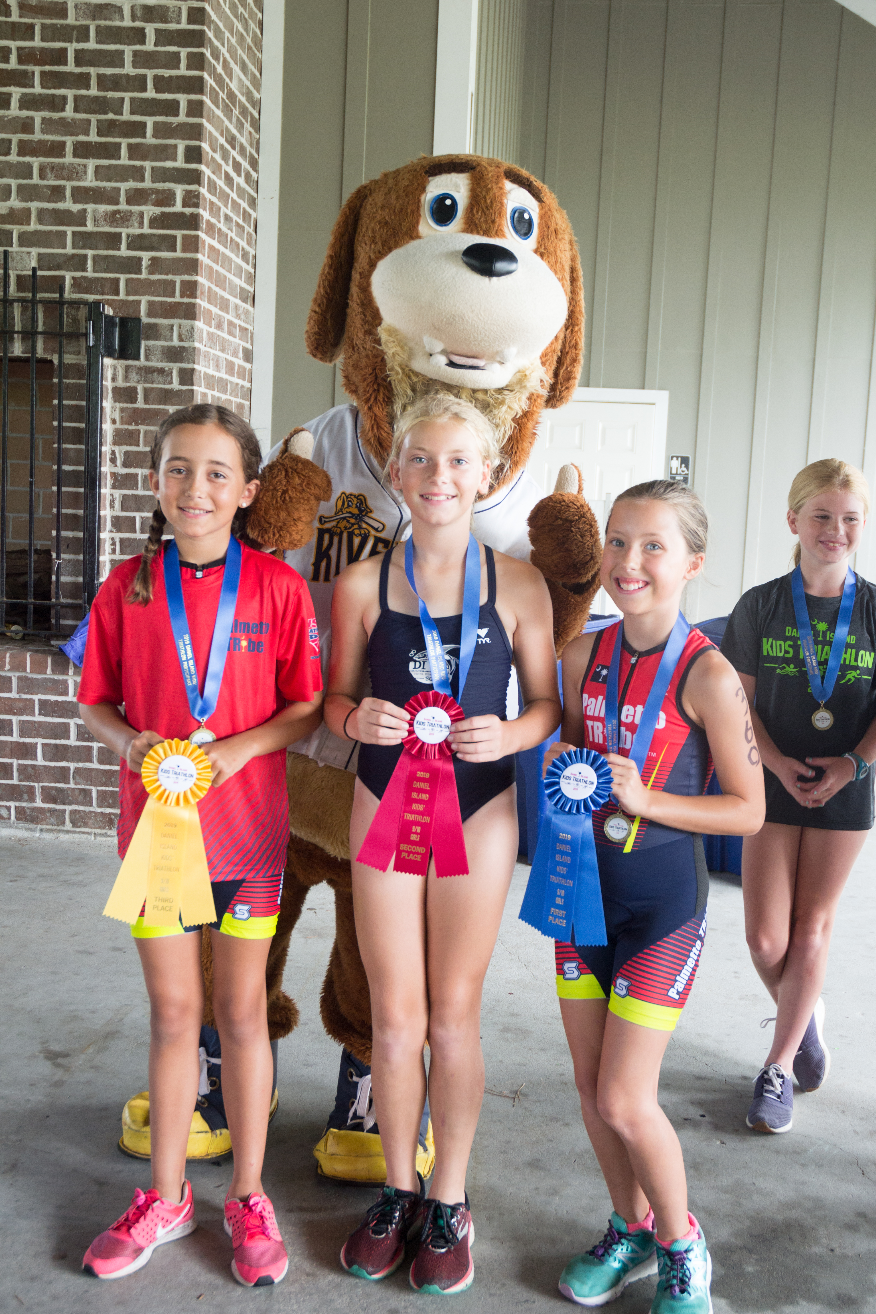 Winners in the 9-10 year-old girls' category (100 meter swim, 2.4 mile bike, ½ mile run): Ansley Kate Chapman (1st), Haley Franko (2nd) and Ginny Cason (3rd).