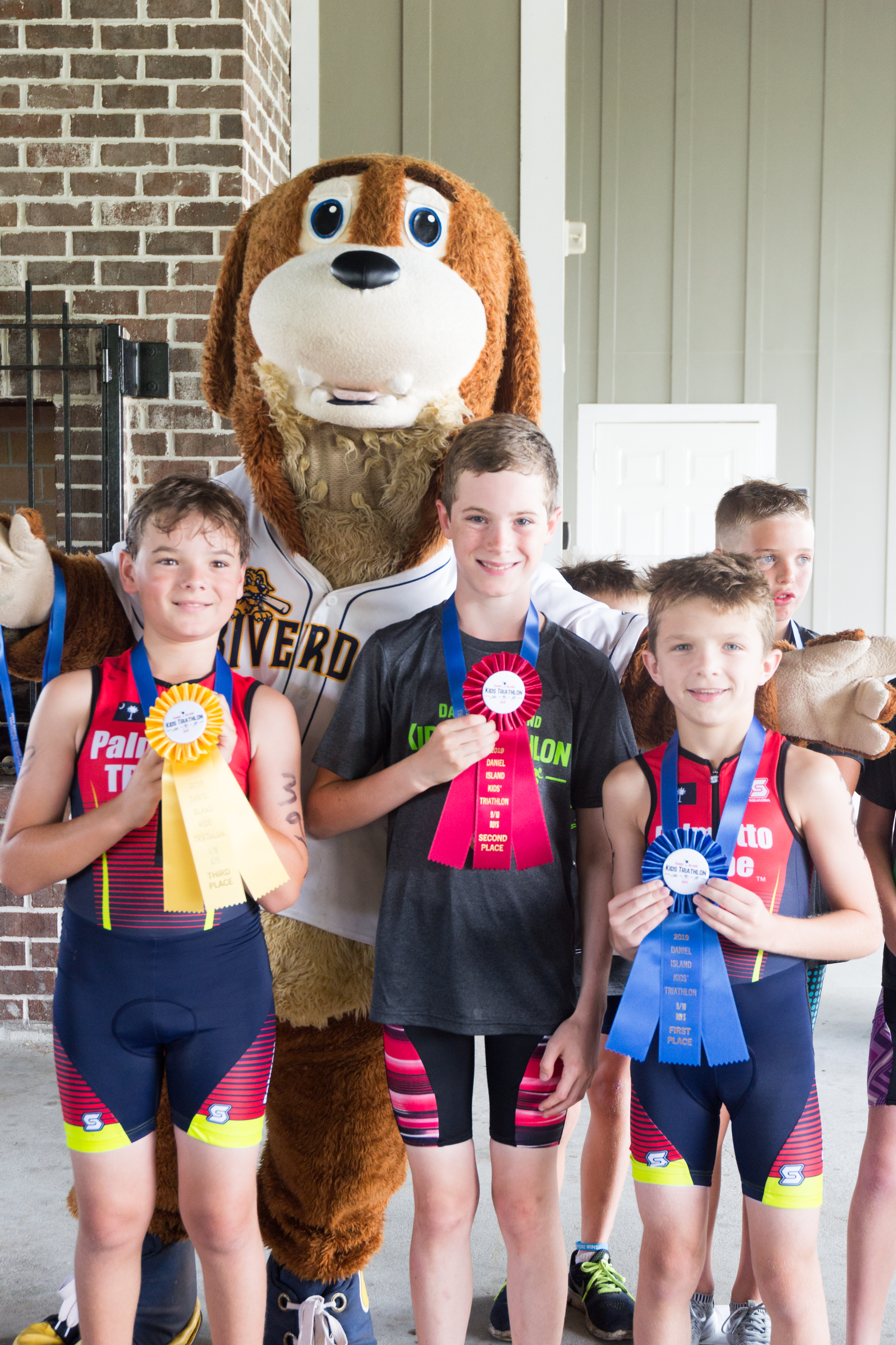 Winners in the 9-10 year old boys' category (100 meter swim, 2.4 mile bike, ½ mile run): Jack Ham (1st), Connor Good (2nd) and Sean Wilson (3rd).