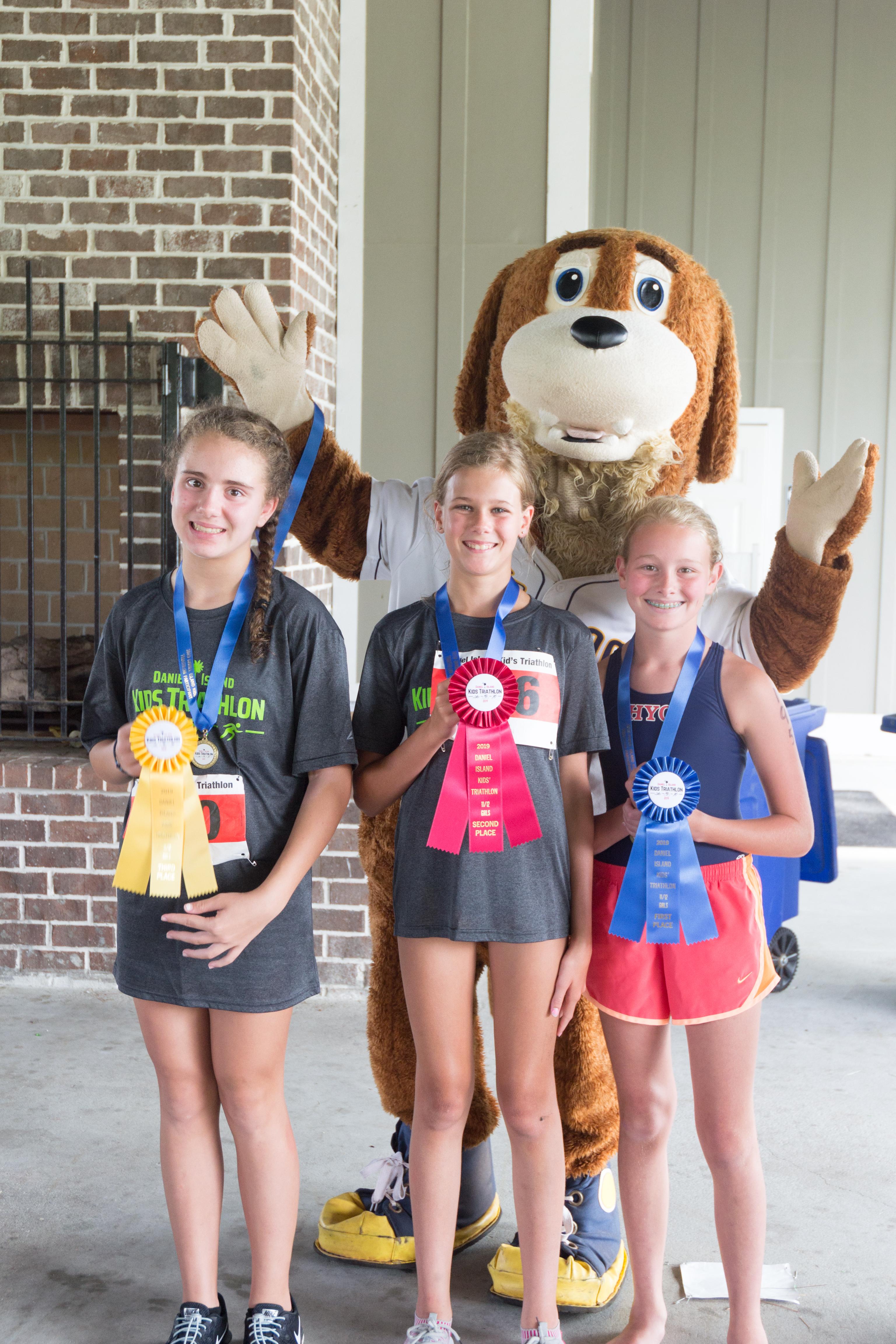 Winners in the 11-12 year old girls' category (200 meter swim, 5.5 mile bike, 1 mile run): Elizabeth Kelley (1st), Elena Evin (2nd) and Elizabeth Maltezos (3rd).