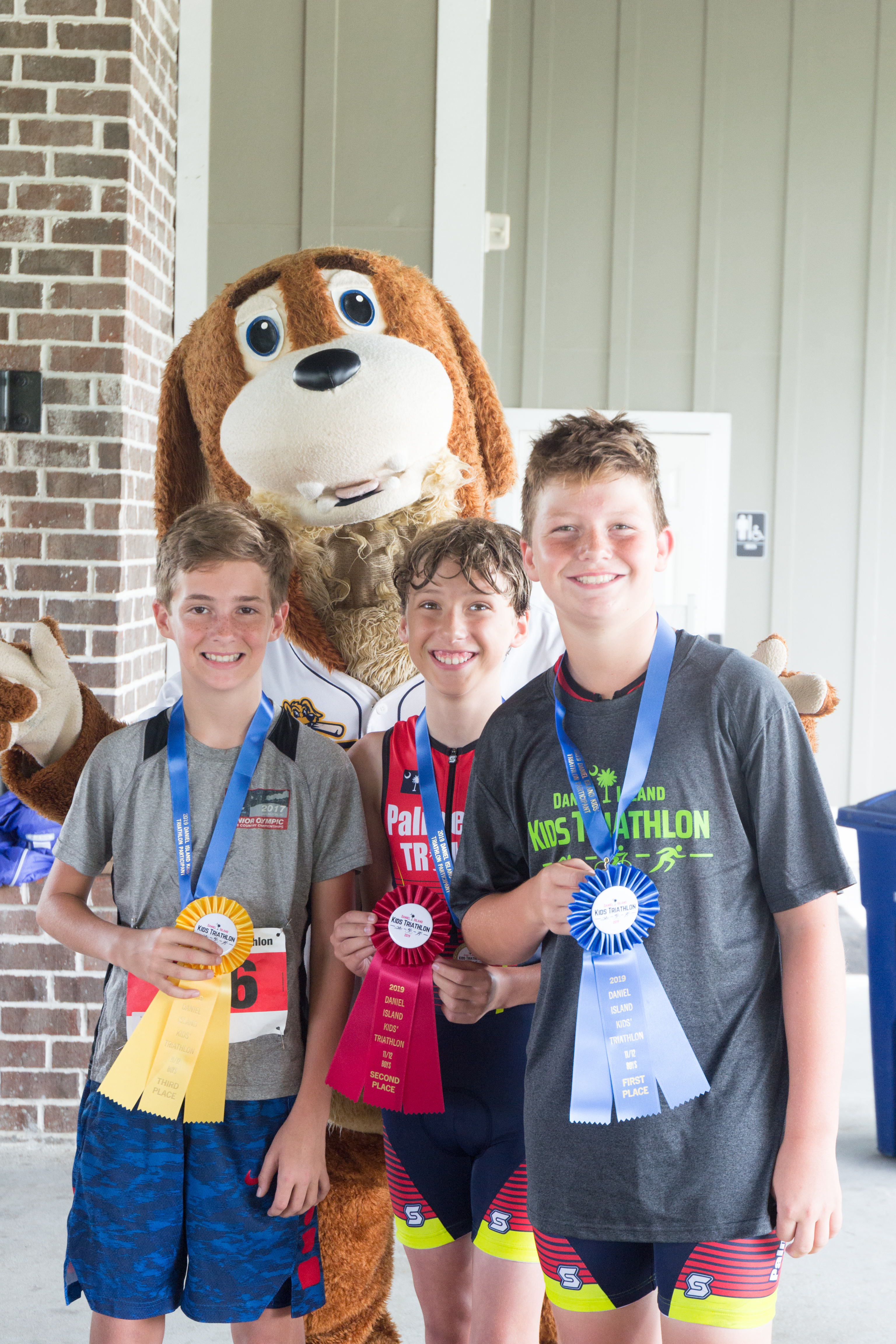 Winners in the 11-12 year old boys' category (200 meter swim, 5.5 mile bike, 1 mile run): Bryce May (1st), Luke Chapman (2nd) and Wesley Patterson (3rd).