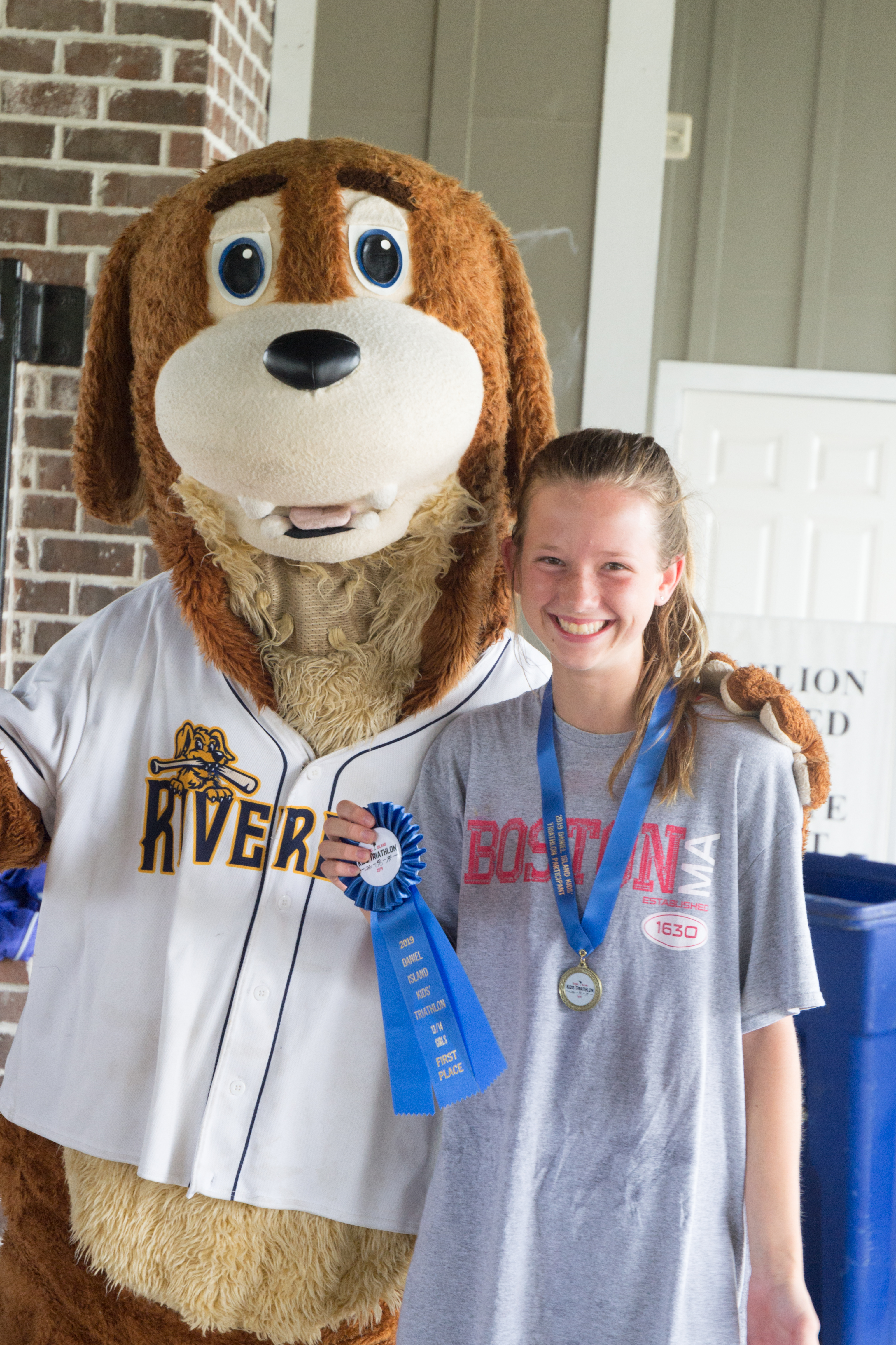Winner in the 13-14 year old girls' category (200 meter swim, 5.5 mile bike, 1 mile run): Josephine May (1st).