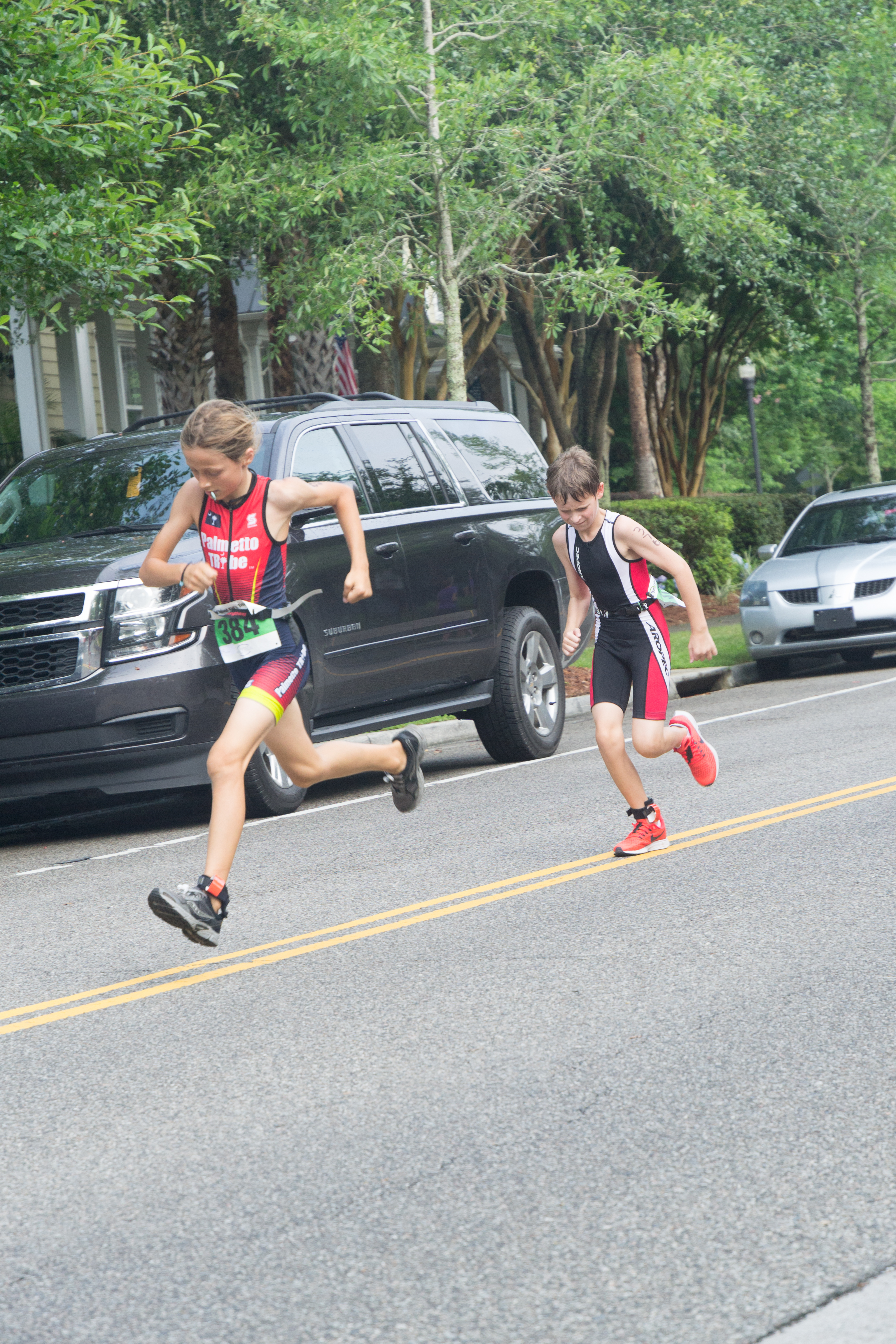 Ninety-seven young athletes first swam laps at Pierce Park Pool and then took to the streets of Daniel Island to bike and run in this year's event!