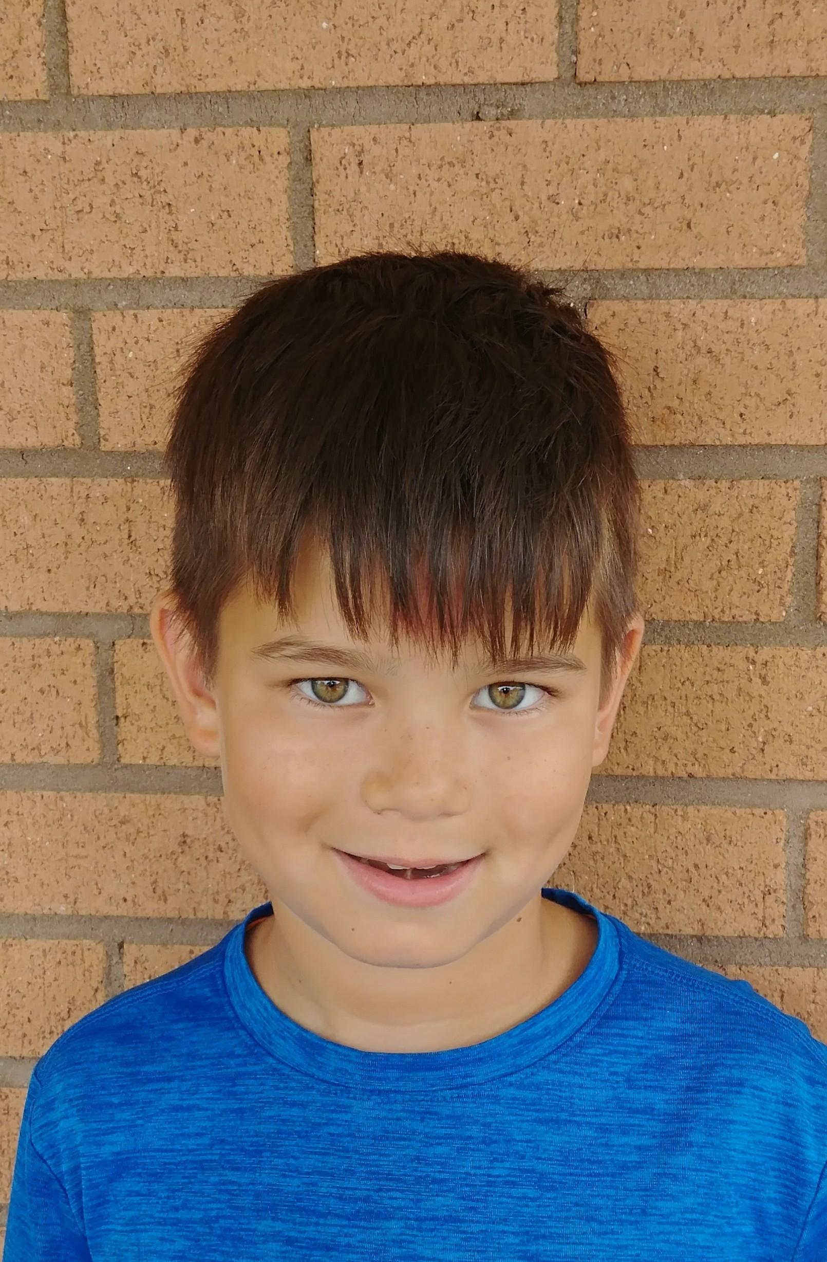 A swimmer because I do the swim team.  Luke  Age 8