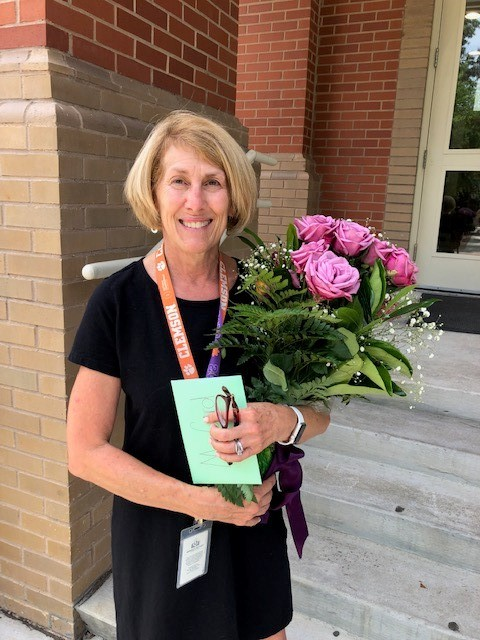 Provided - Daniel Island School teacher Kim Card holds a bouquet of flowers in celebration of her retirement after 40 years as an educator.