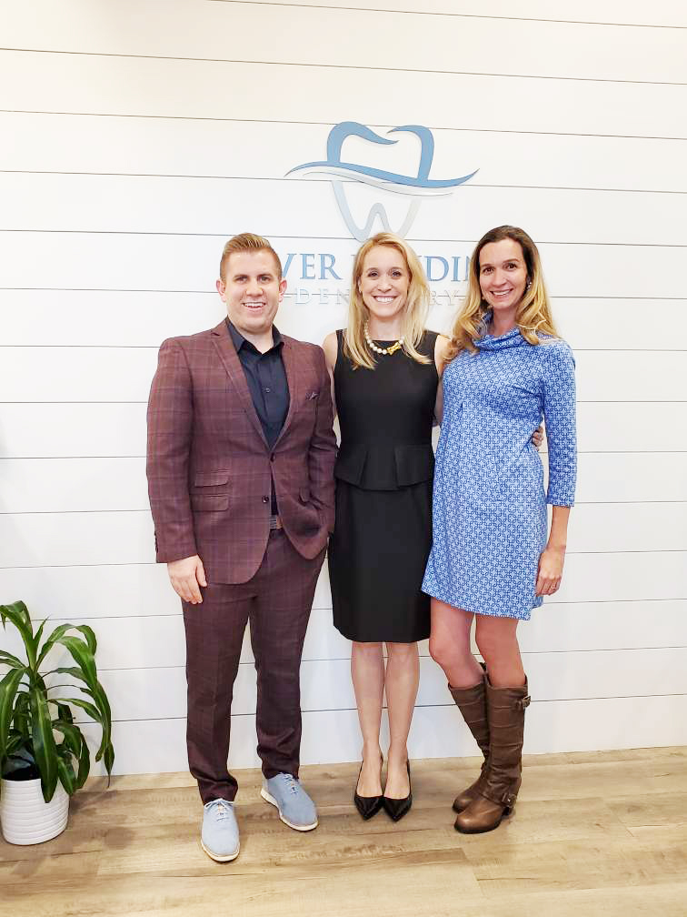 Meet the doctors at River Landing Dentistry: Dr. Alex Kusek, Dr. Ellen Paulisick, and Dr. Rebeca Zechmann.