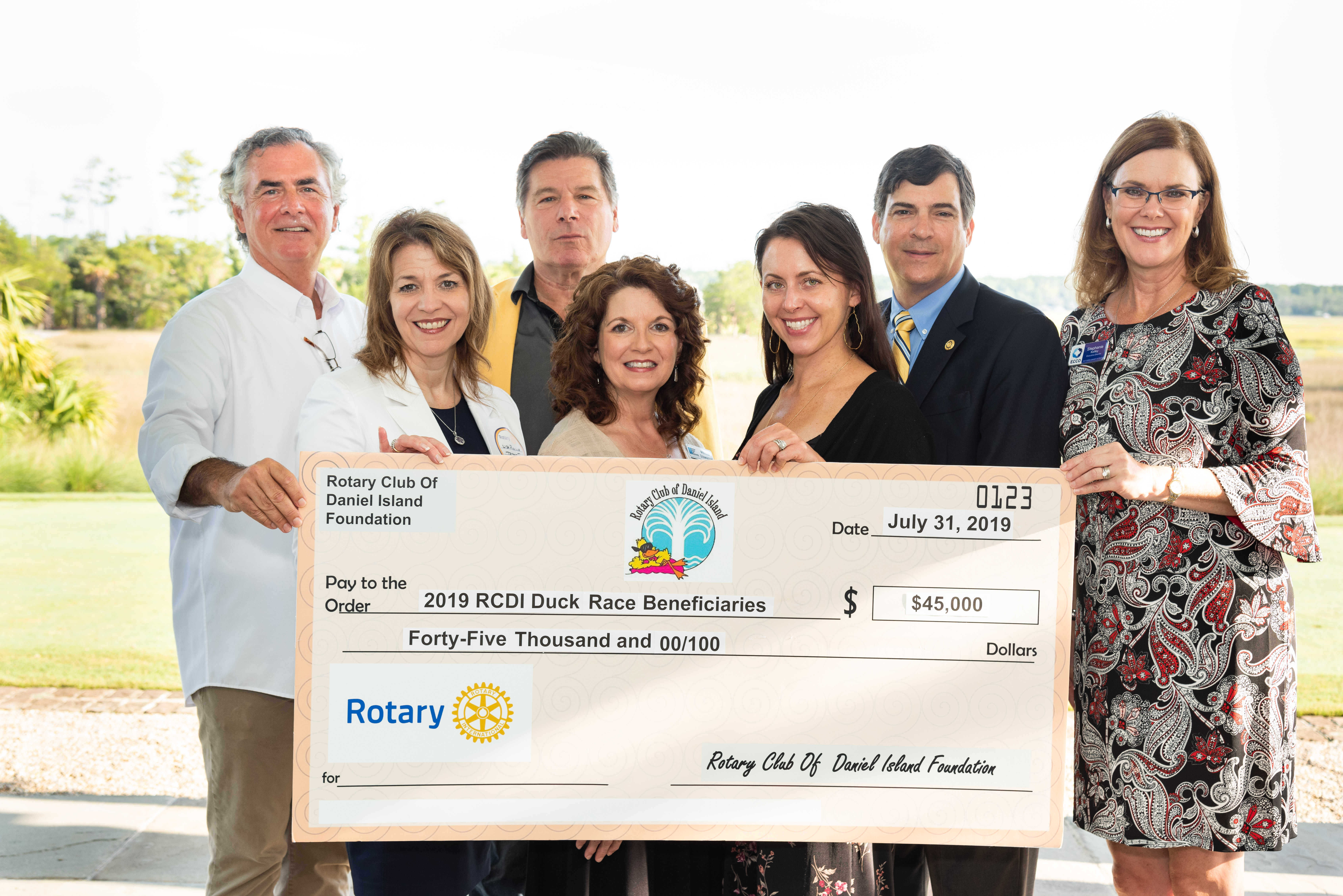 The beneficiaries of this year's Rotary Duck Race were delighted to receive checks from the Rotary Club of Daniel Island last week. Pictured left to right are George Roberts, president and CEO of East Cooper Meals on Wheels; Lisa Piccolo of Trident Technical College; Bill Cannon, Rotary president; Melissa Stowasser of Trident Technical College; Jeanine Gillette of Camp Happy Days; Keith Rumrill of Trident Technical College; and Stephanie Kelley of East Cooper Community Outreach.