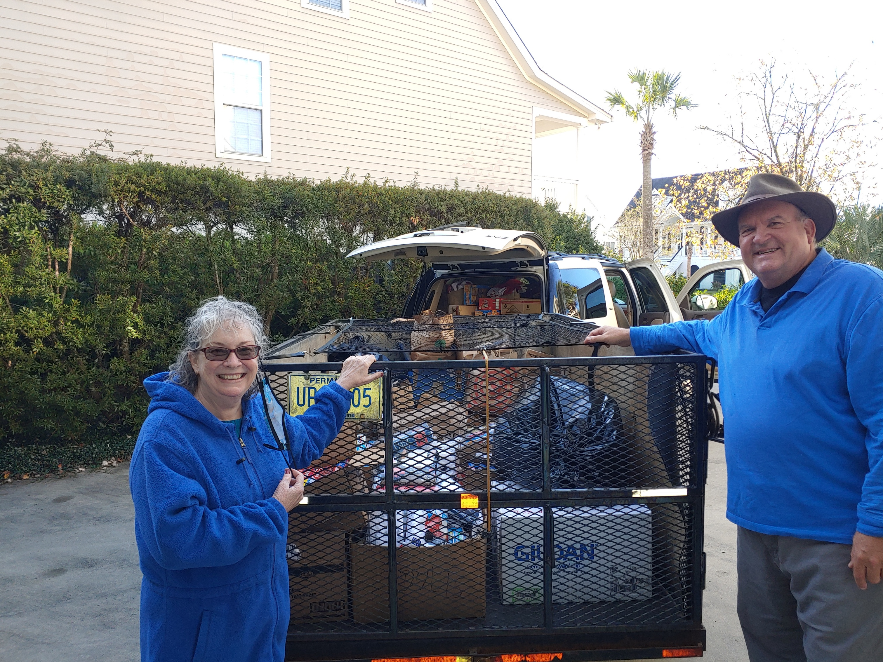 Saint Clare of Assisi parishioners Nancy Bloodgood and Jady Fryml prepare to deliver the first of several loads of Christmas treats to the Lieber and MacDougall Correction Center in Ridgeville. The 1,750 inmates received a heartwarming gift this Christmas, thanks to the efforts of parishioners Fryml, Bloodgood, Kelly Loughery, and Nick Armandi of the parish's prison ministry team that collected over $12,000 from Saint Clare of Assisi members, the Daniel Island Rotary Club, and several other church communities. The funds enabled the team to give stockings filled with socks, t-shirts, toiletries, and other items to the inmates. Visits to the inmates by families and friends of the inmates were halted in February due to the pandemic, contributing to higher tensions within the prison communities. These small gifts mean a great deal to the recipients who realize that somebody on the outside is thinking about them. The prison ministry team will also purchase a video projector for the MacDougall chapel.
