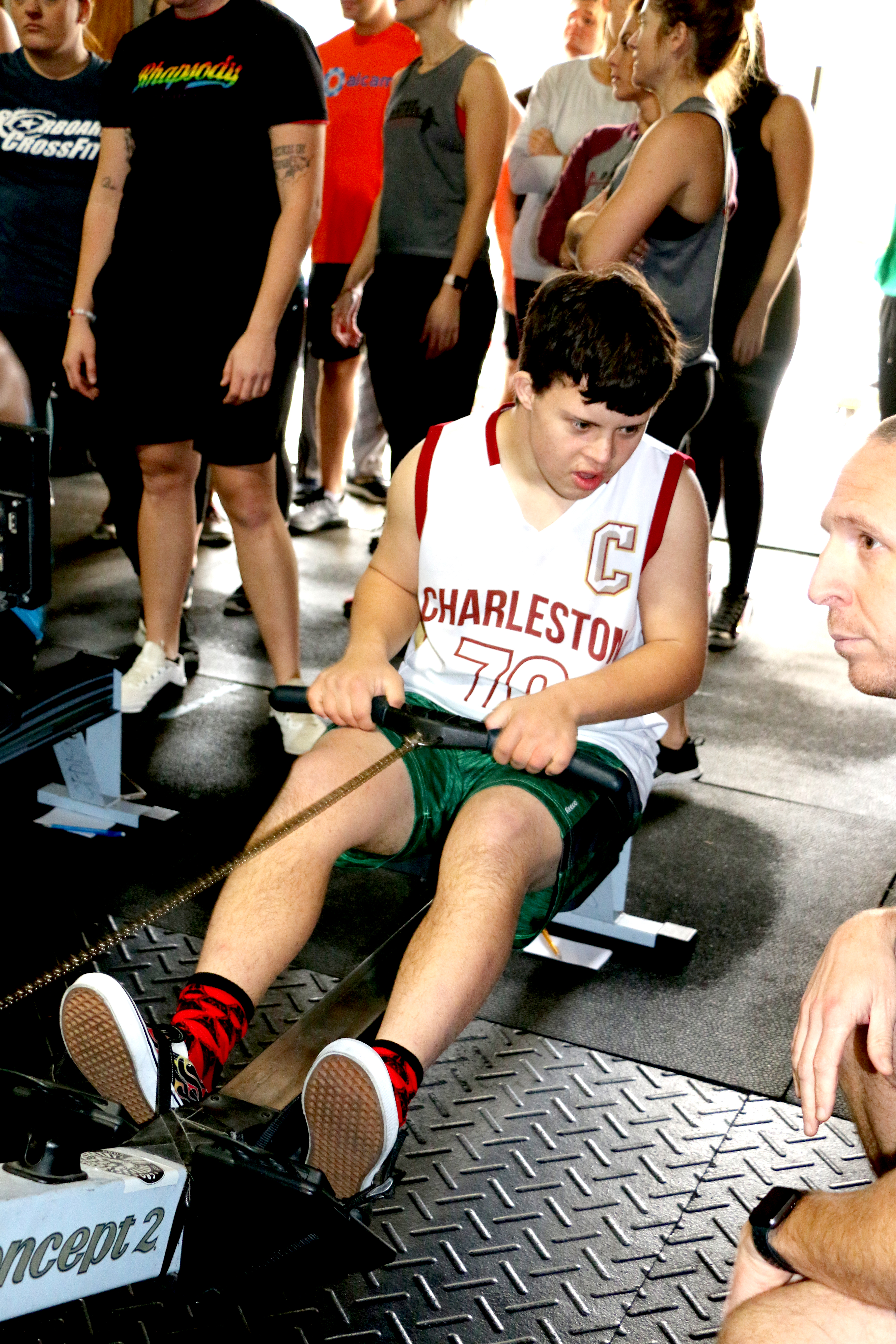 Special Olympian Grant Baker gets a word of advice from a coach as he rows.