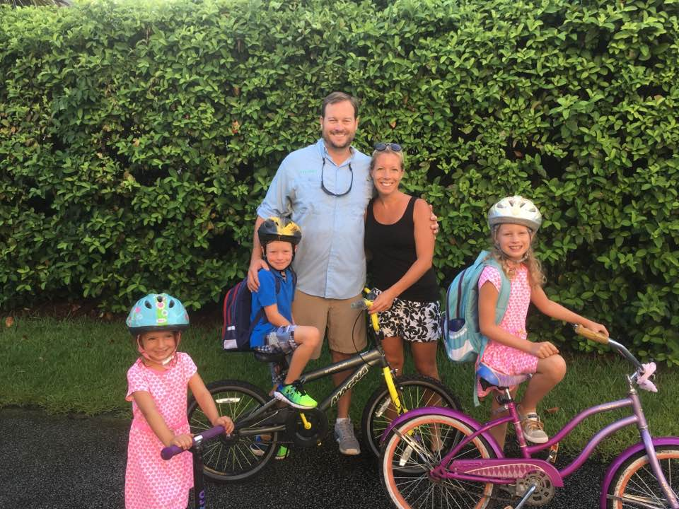 Nathan and Kara Delpino with their children - Ava, a third grader at DIS; Chase, a 1st grader at DIS; and Tessa, who is in the 4-year-old preschool class at Holy Cross Church on Daniel Island.