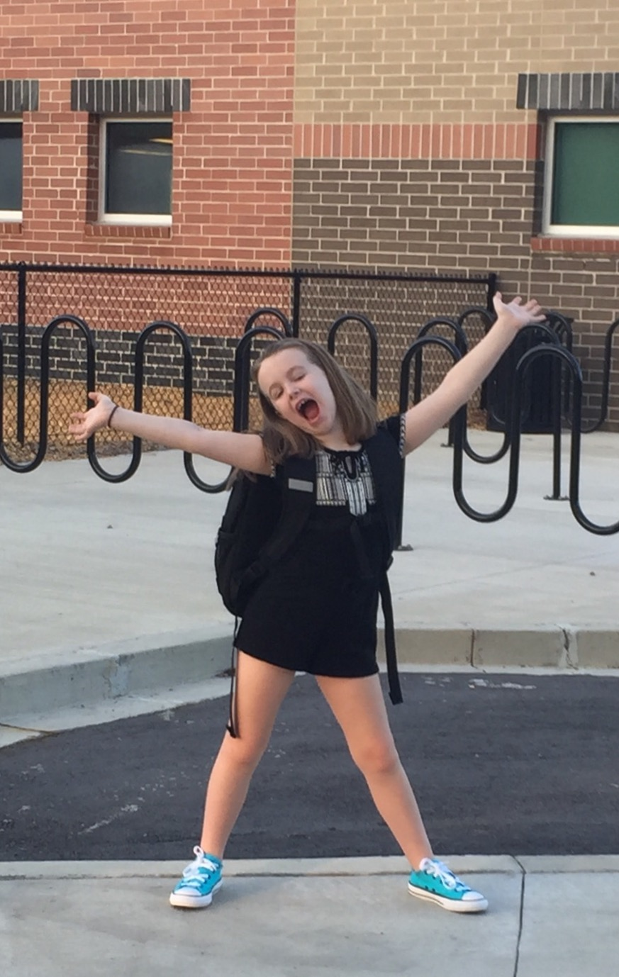 Mia Lowe, third grade, Philip Simmons Elementary School, can't hide her excitement about her first day of school!