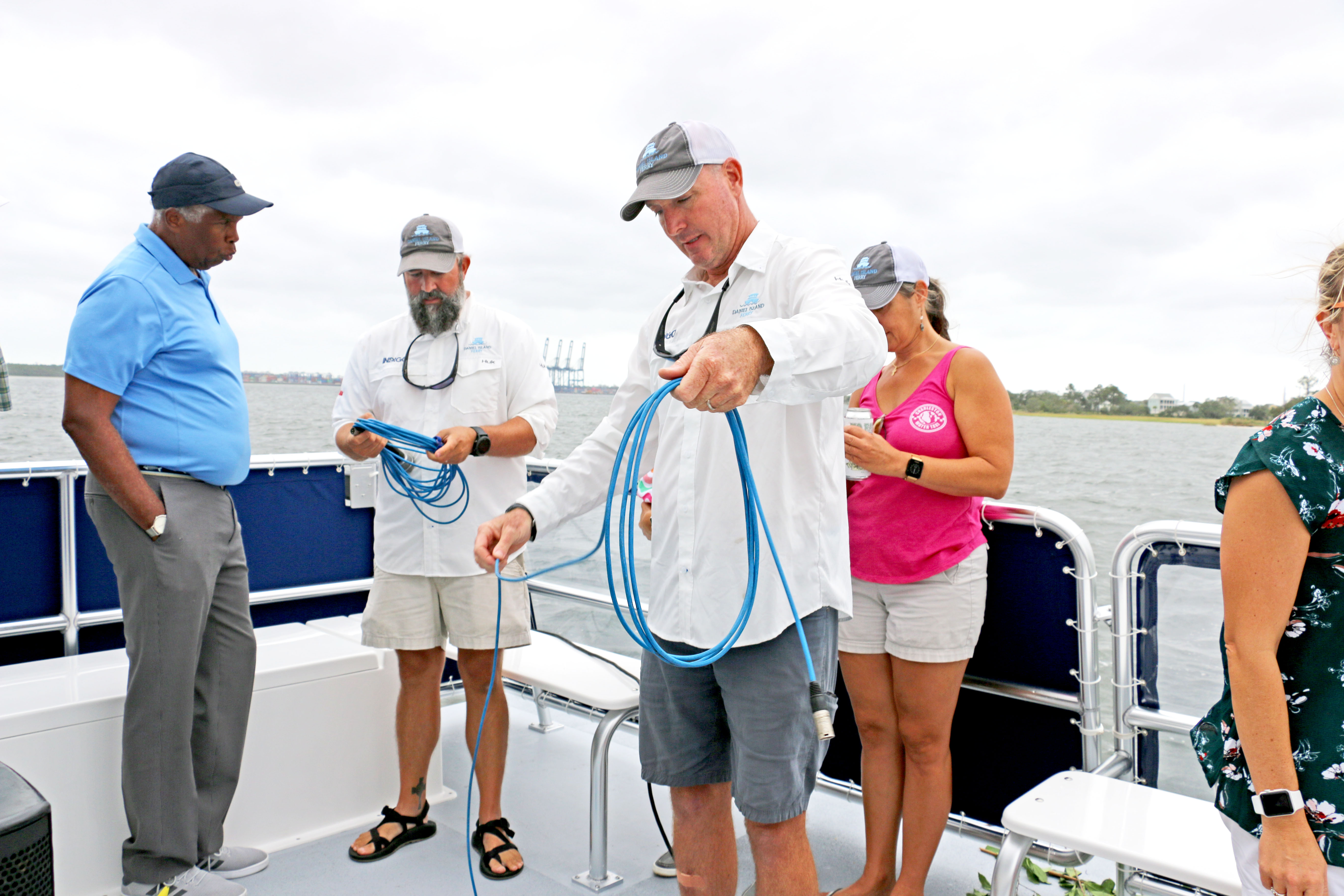 Crew members talk with interested passengers aboard Indigo following the boat's christening ceremony.
