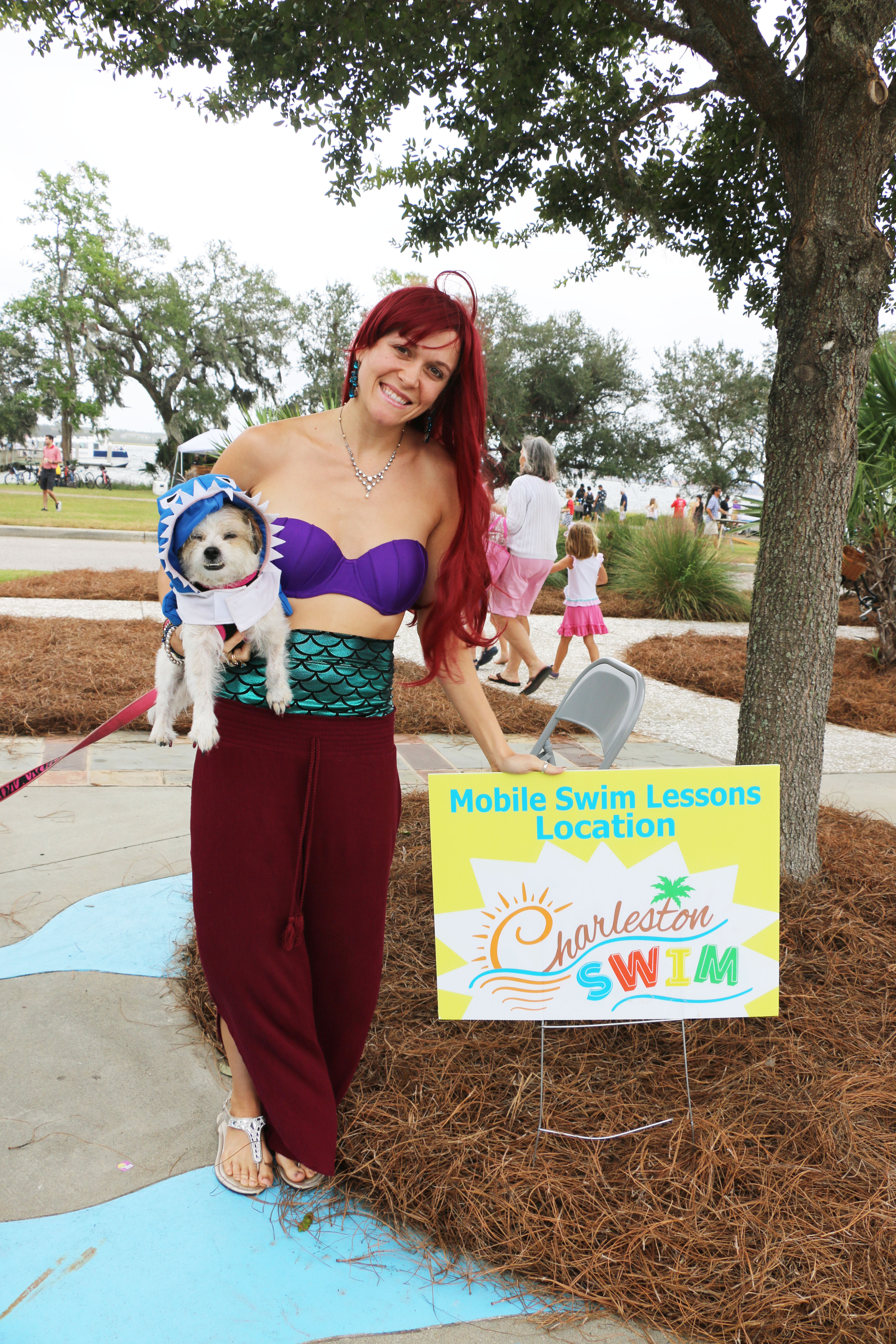 Amy Hassinger from Charleston Swim School is dressed as a mermaid with her dog, Blossom.
