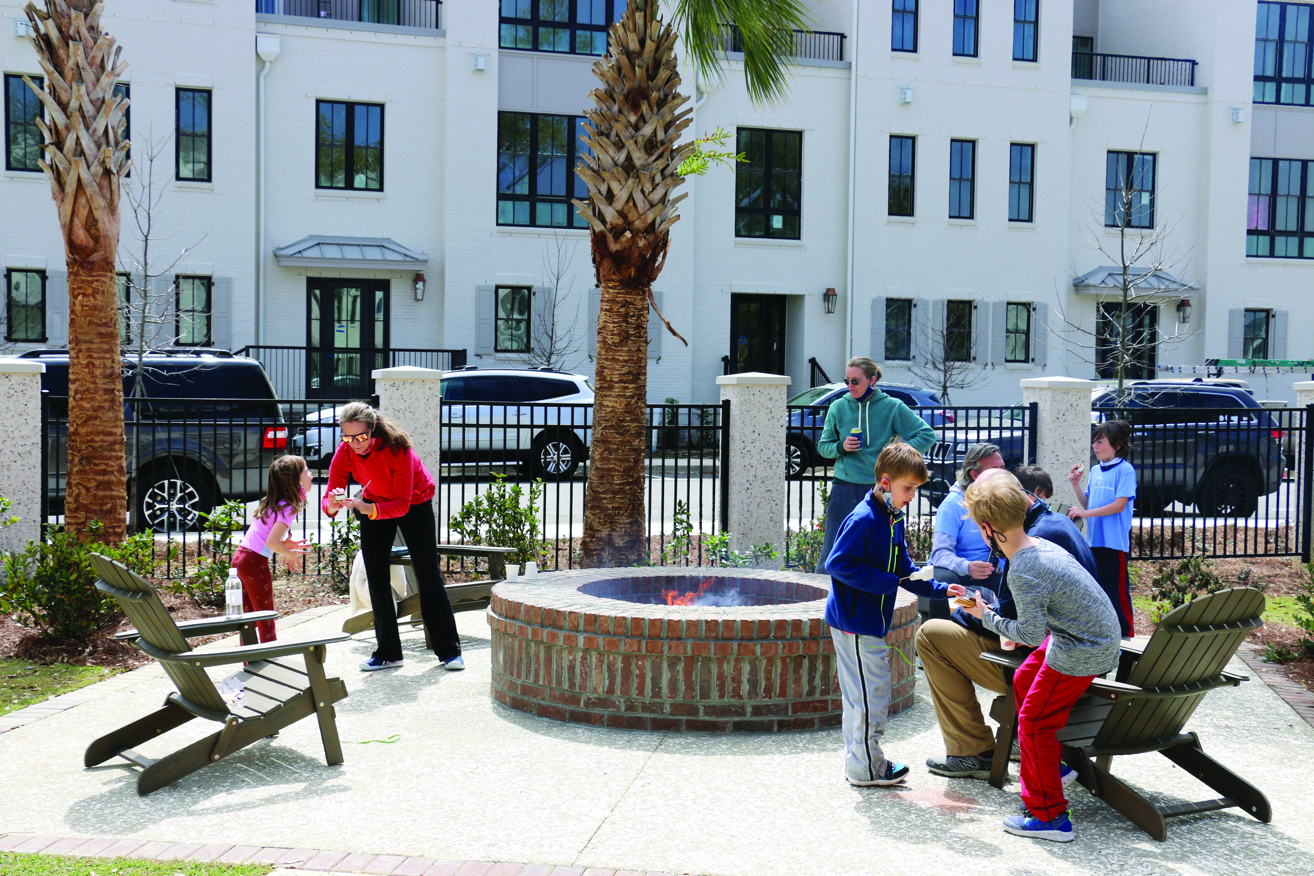 Children enjoyed roasting marshmallows and making s'mores at Waterfest. The fire pit is adjacent to the swimming pool complex in the community area for residents of the nearby condominiums and townhouses.