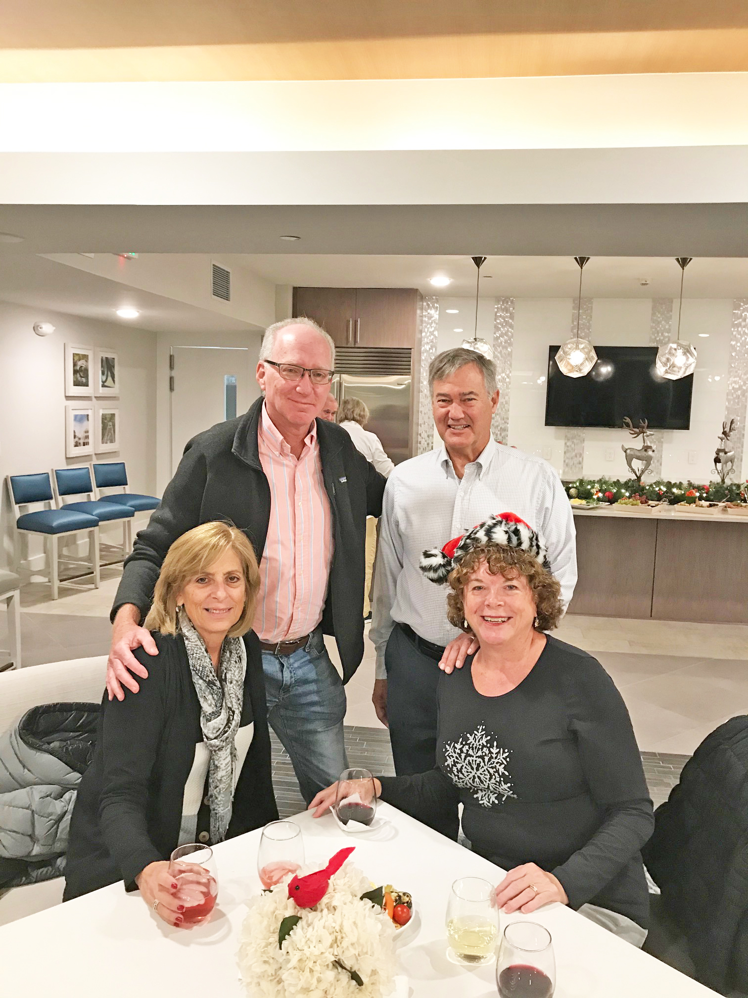 Daniel Island residents celebrate the holidays together. Standing: Jeff Hammer and Bruce Markham. Seated: Irene Hammer and Kathy Markham.