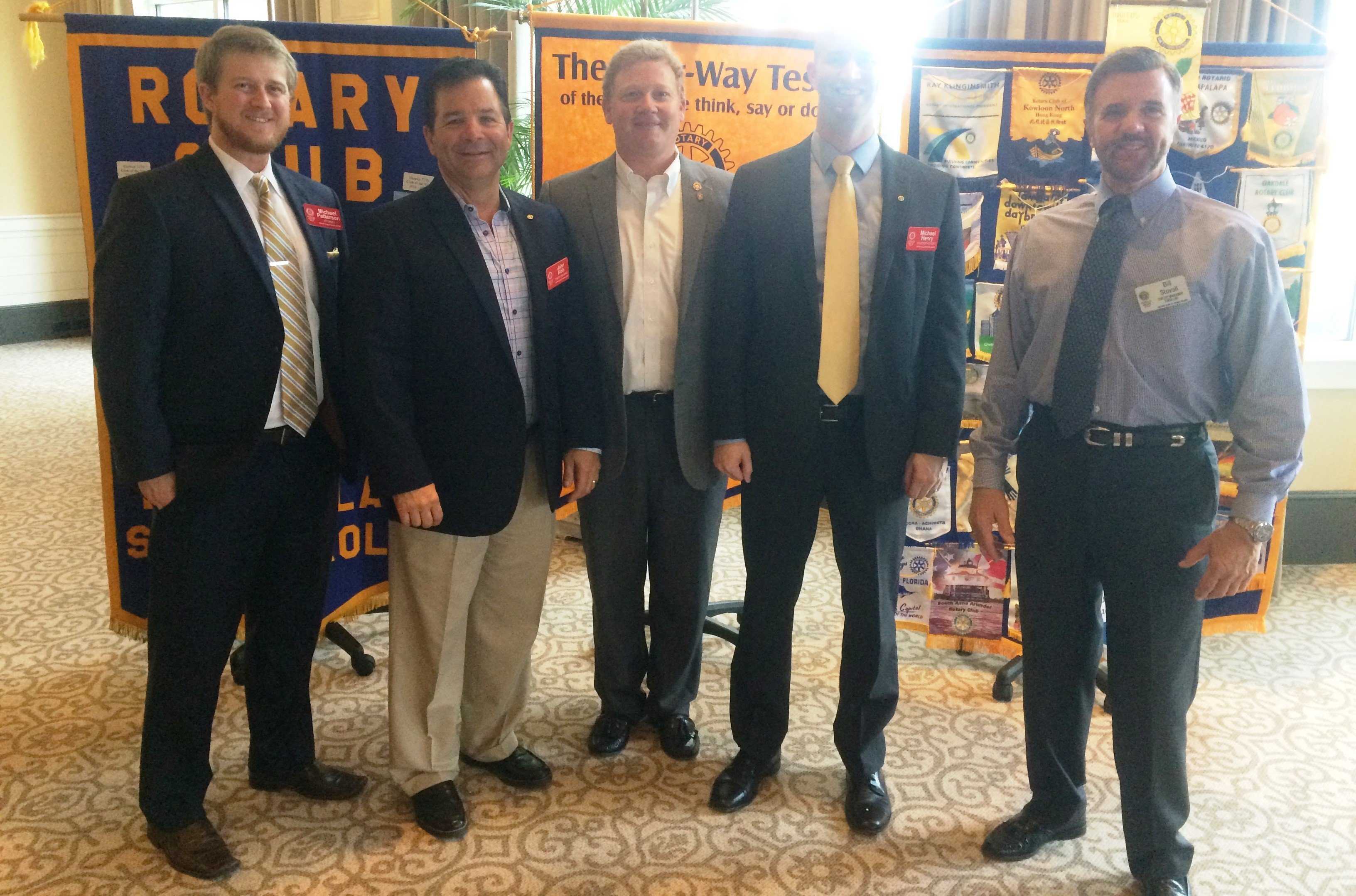 (L to R) Daniel Island Rotarians Michael Patterson, John Kish, Gray Ives, Michael Henry, and Bill Stovali pose at the club's March 1 meeting at the Daniel Island Club. Kish and Henry were both inducted as new members.