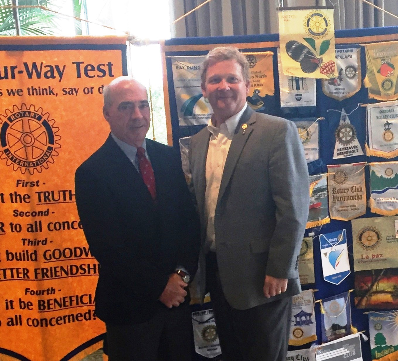 "Daniel Island resident Mike Ferrara, (left) author of the book ""The Land of a Million Elephants,"" served as guest speaker at the program. Ferrara is pictured here with Daniel Island Rotary Club President Gray Ives."