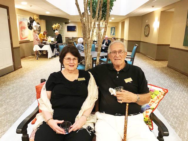 Daniel Pointe residents Suzanne Flake and Louis Dardozzi take a respite during the celebrations.