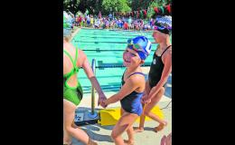 Ronel St Germain walks to the end of the pool to compete in the 25 butterfly event at last week's City Meet.