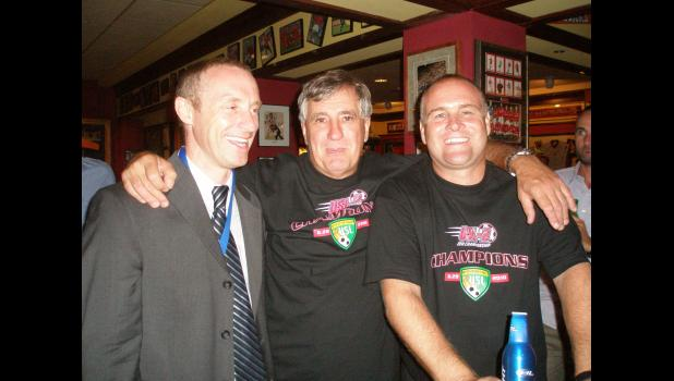 Charleston Battery team president Andrew Bell with club founder Tony Bakker and head coach and general manager Mike Anhaeuser after their 2010 USL Second Division Championship win. It was the third of the club's four league championships.