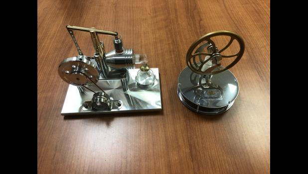 Two model engines and motors that will be used during the STEM Thursday series at the library.