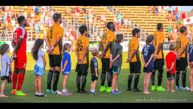 More than 100 honor students at the Daniel Island School were recognized for their academic achievements during halftime at the June 24 Charleston Battery game at MUSC Health Stadium. The students were given free tickets to the game after receiving all A's during the recently completed school year. As shown in the picture above, some of the students got to serve as player liaisons for the match and walked out with the teams prior to kickoff for the National Anthem and coin toss.
