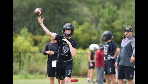 Philip Simmons High School's Ian McCorkle throws a pass during a 7-on-7 session at Cane Bay High School in June.