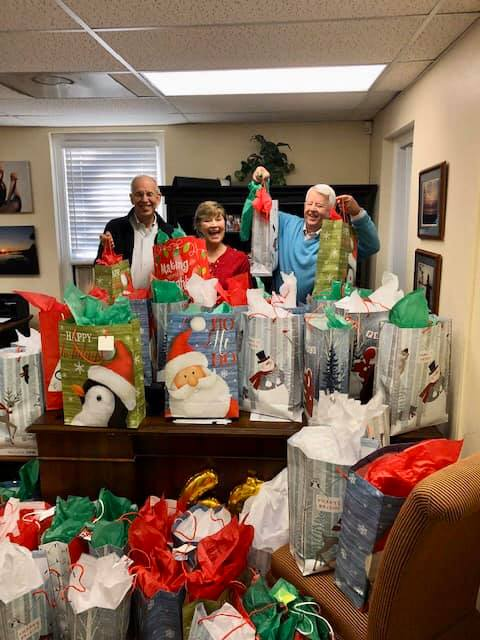 Rotary Club members fill gift bags with towels as part of a program run through Meals for Wheels.