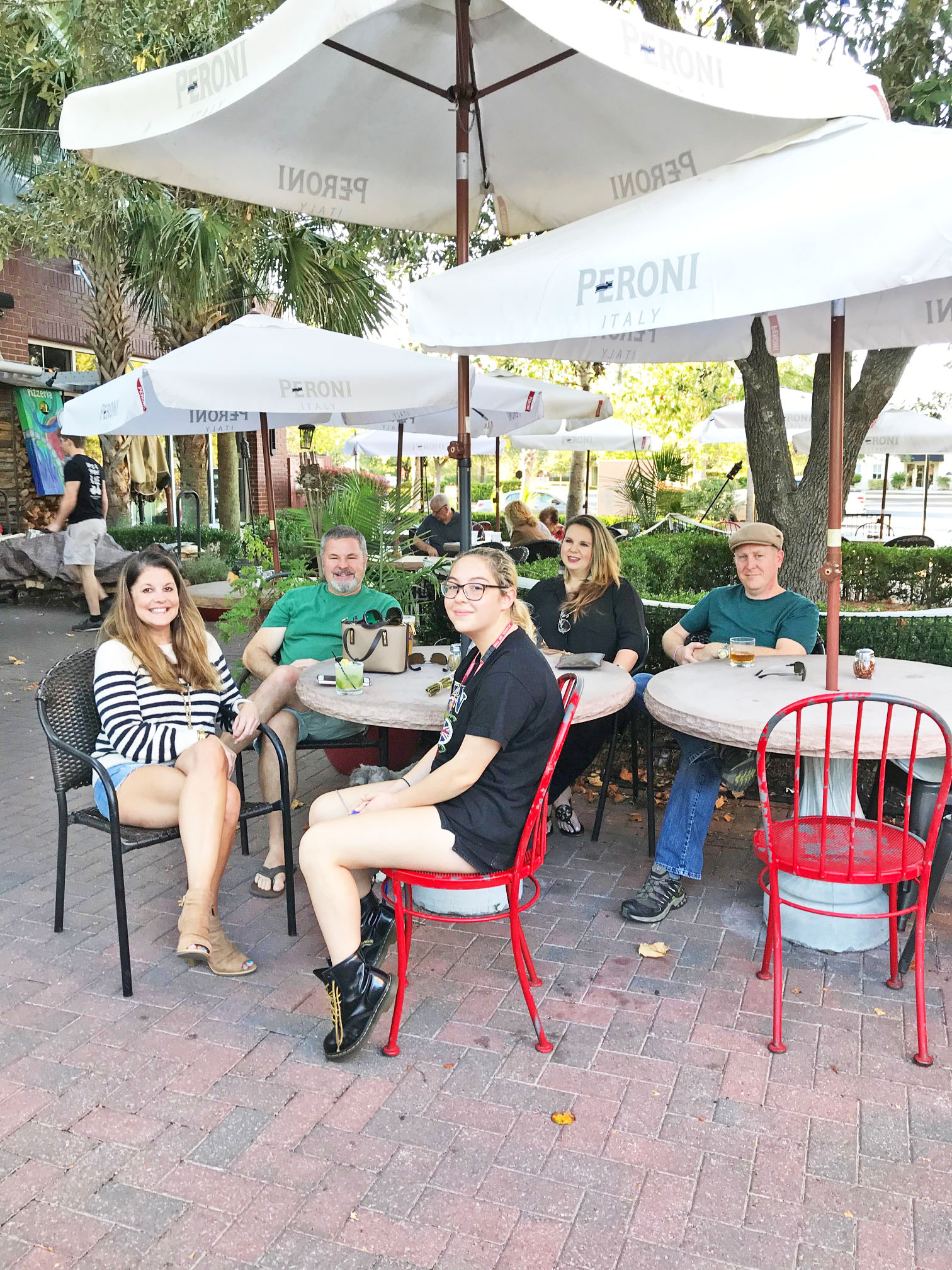 Sara Hannapel, Ted Hannapel, Lauren Messina, Jeremy LaRowe, and Annelise Teves take in the celebratory atmosphere while dining outside at Vespa.